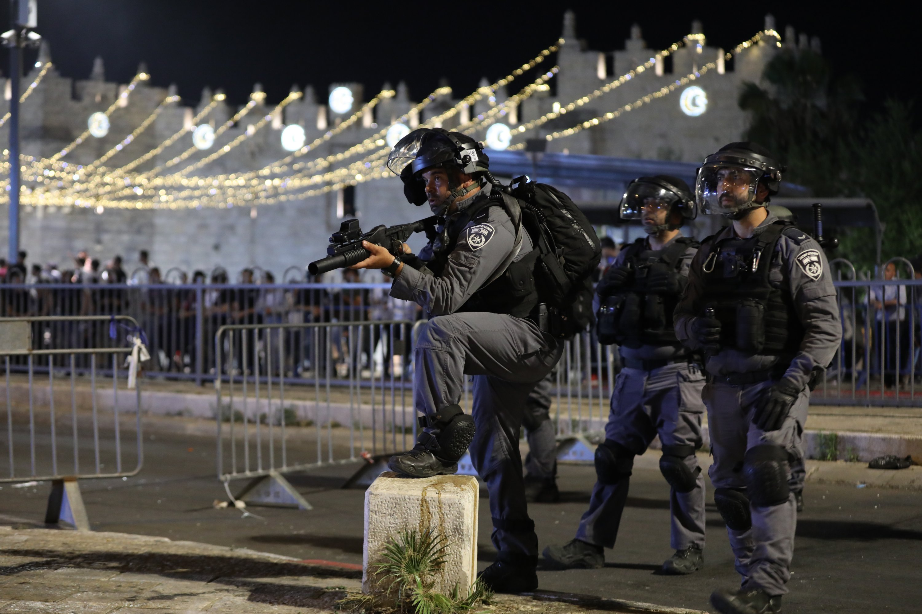 Israeli police are seen during attacks targeting Palestinians at Damascus Gate on Laylat al-Qadr during the holy month of Ramadan, in Jerusalem's Old City, May 8, 2021. (EPA Photo)