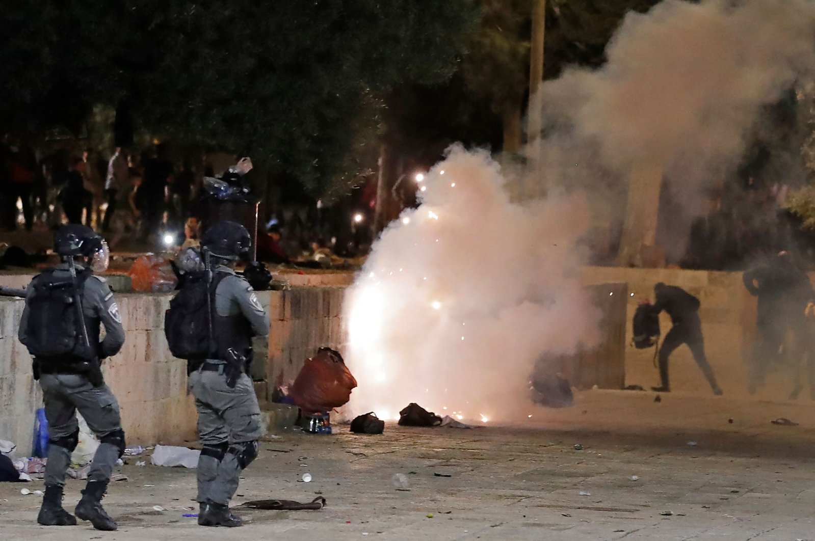 Tear gas billows as Israeli police officers raid the Al-Aqsa Mosque and attack Palestinian worshippers in East Jerusalem, May 7, 2021. (AFP Photo)