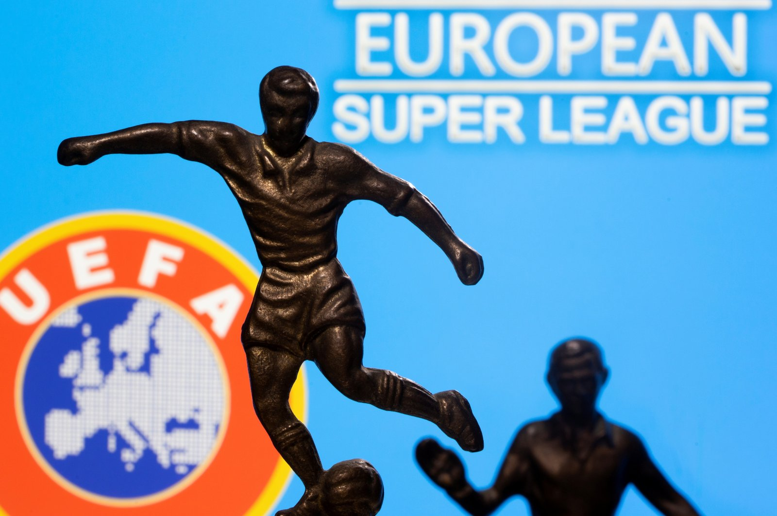 """Metal figures of football players are seen in front of the words """"European Super League"""" and the UEFA logo in this illustration, April 20, 2021. (Reuters Photo)"""