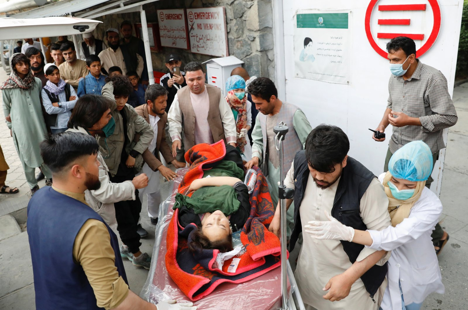 An injured woman is transported to a hospital after a blast in Kabul, Afghanistan, May 8, 2021. (Reuters Photo)