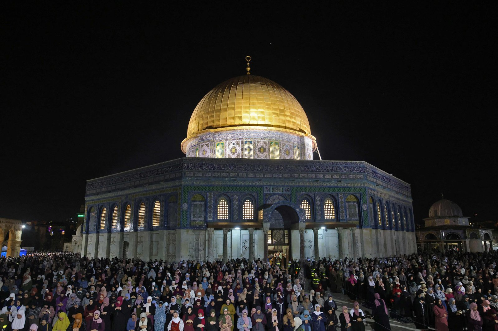Palestinian devotees pray on Laylat al-Qadr (Night of Power) outside the Dome of the Rock in Jerusalem's Al-Aqsa Mosque compound during the Muslim holy month of Ramadan, Jerusalem, May 8, 2021. (AFP Photo)