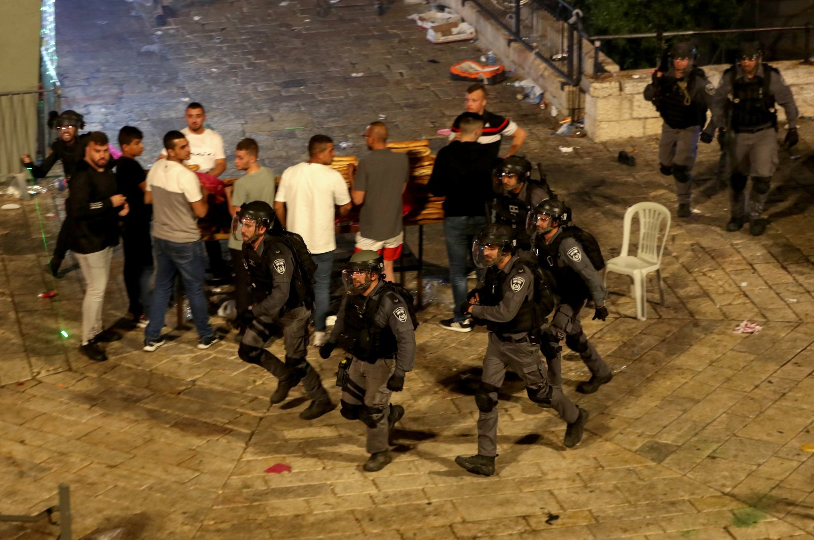Israeli police are seen during attacks targeting Palestinians at Damascus Gate on Laylat al-Qadr during the holy month of Ramadan, in Jerusalem's Old City, May 8, 2021. (Reuters Photo)
