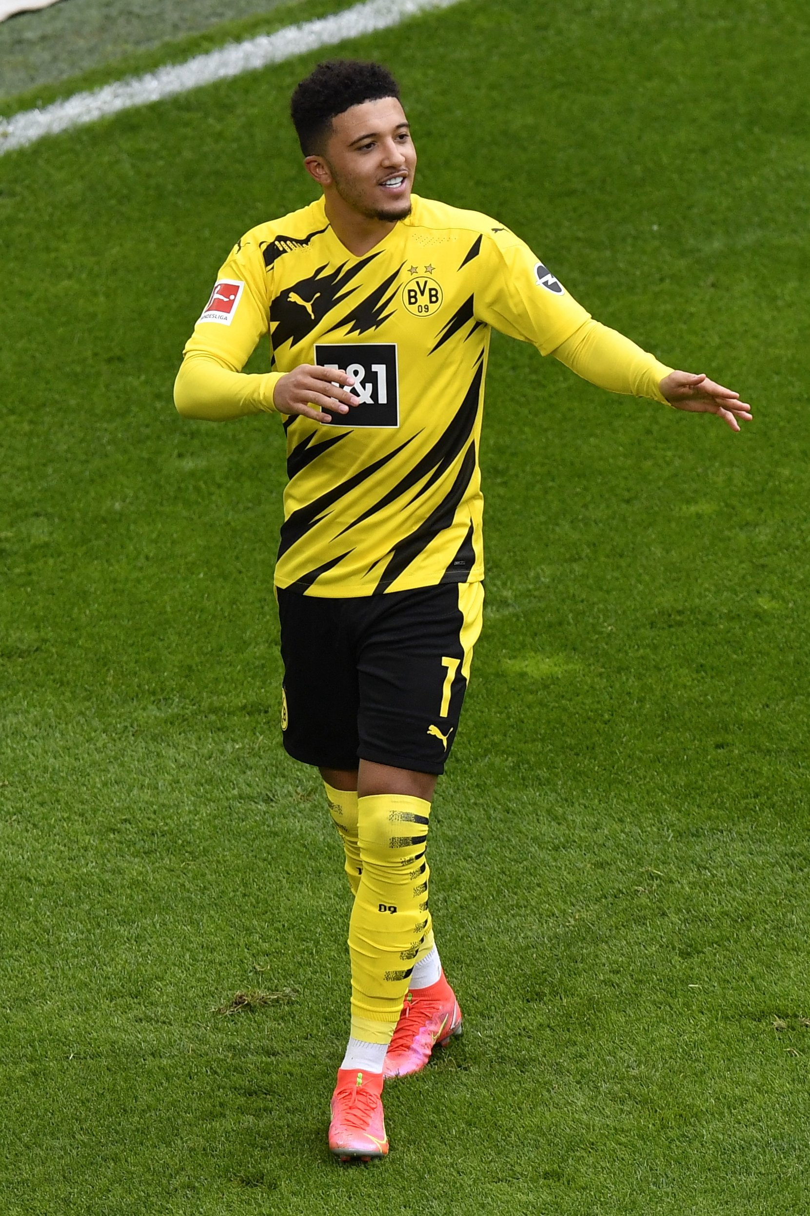Dortmund's Jadon Sancho celebrates after scoring his side's second goal during a Bundesliga match against RB Leipzig in Dortmund, Germany, May 8, 2021. (AP Photo)