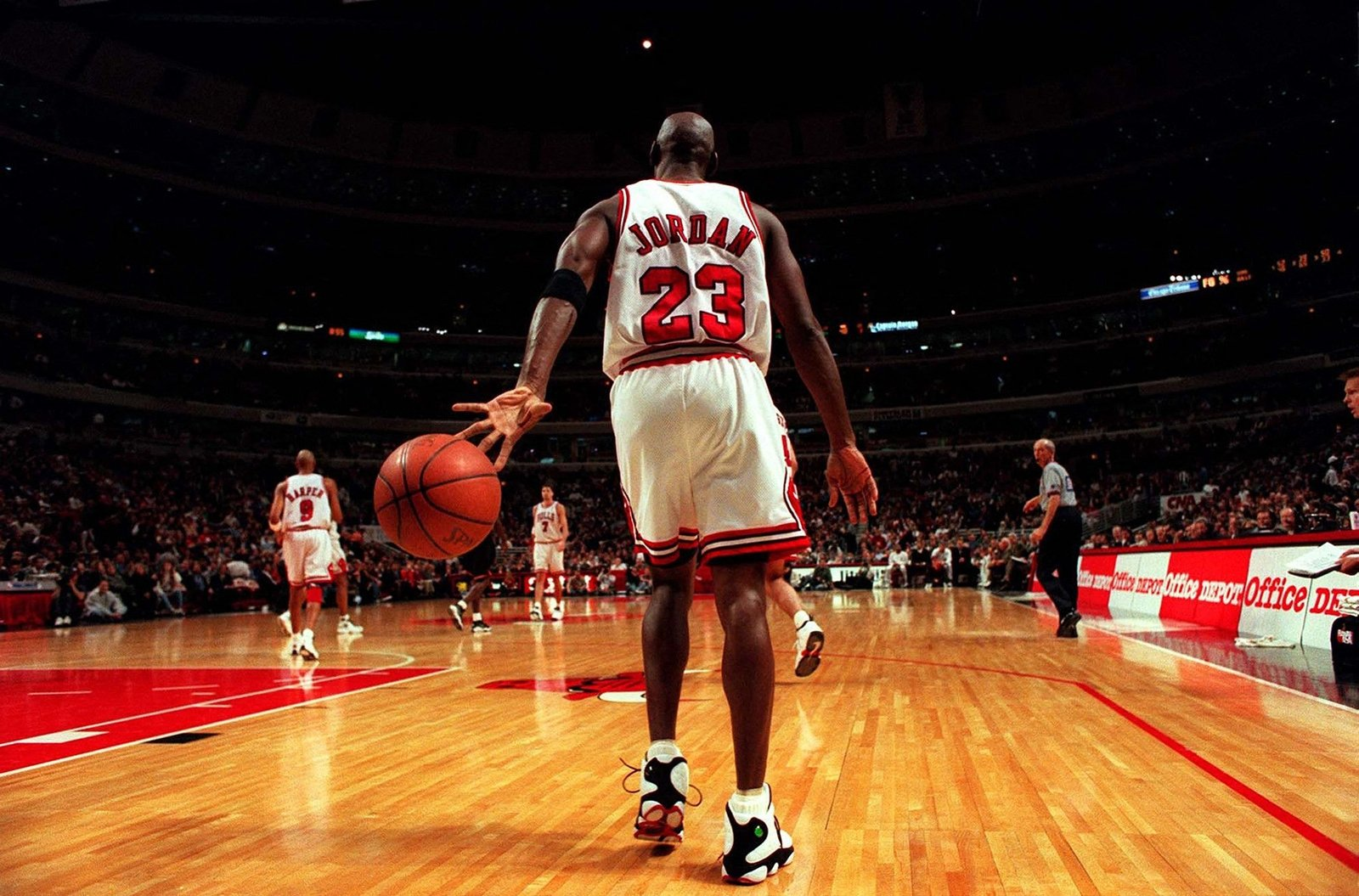 Michael Jordan heads up court during a game at the United Center in 1997. (Patrick D. Witty/Chicago Tribune/Reuters Photo)