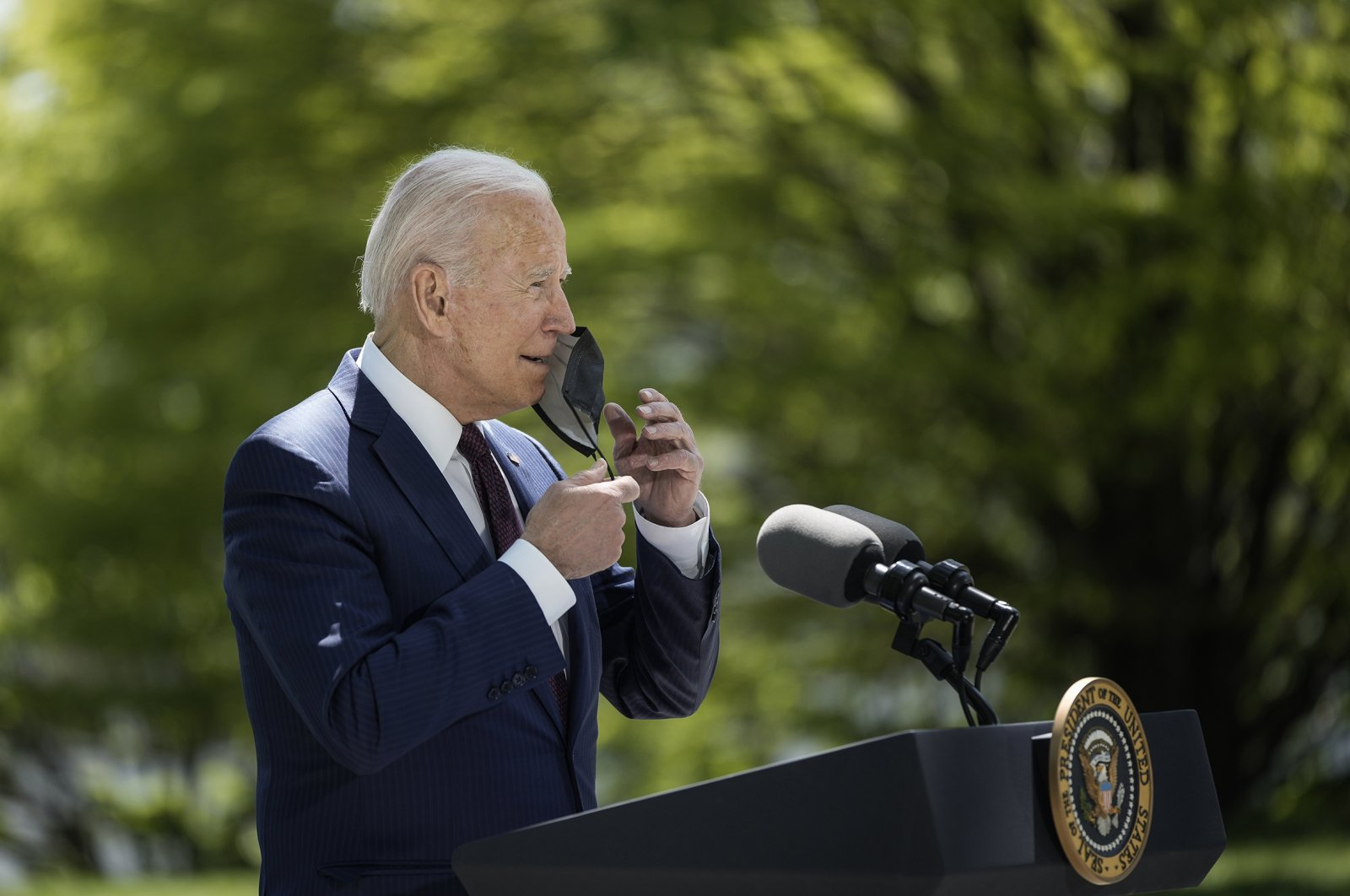 U.S. President Joe Biden removes his mask before speaking about the updated Centers for Disease Control and Prevention (CDC) mask guidance, Washington, D.C., U.S., April 27, 2021. (Photo by Getty Images)