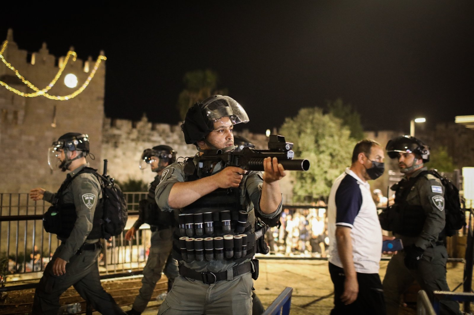 An Israeli police officer holds a gun during Palestinian demonstrations against the forced evictions from the Sheikh Jarrah neighborhood, occupied East Jerusalem, Palestine, May 8, 2021. (Photo by Getty Images)
