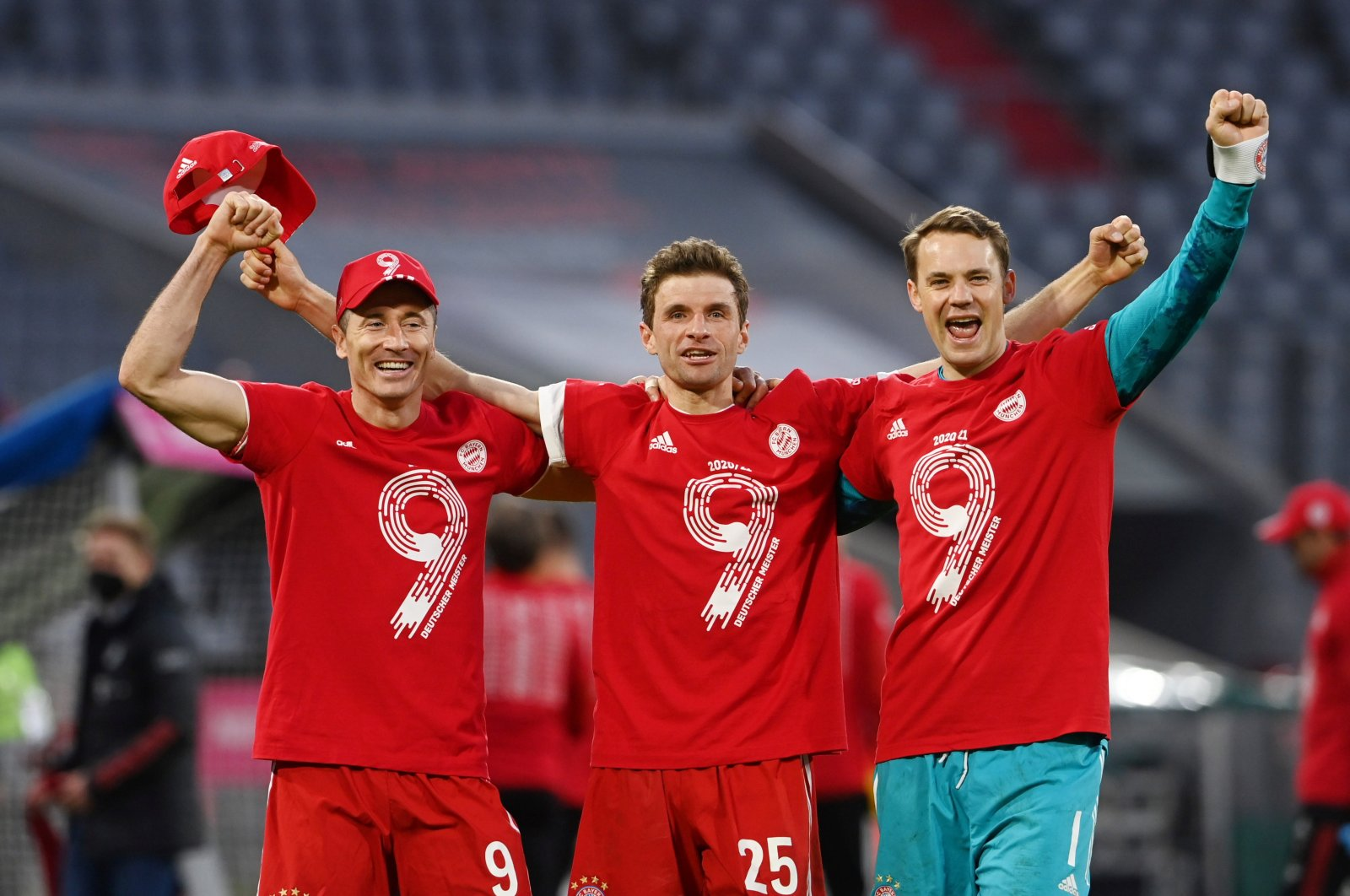 Bayern Munich's Thomas Muller, Manuel Neuer and Robert Lewandowski celebrate winning the Bundesliga after a match against Borussia Monchengladbach at the Allianz Arena, Munich, Germany, May 8, 2021. (Reuters Photos)