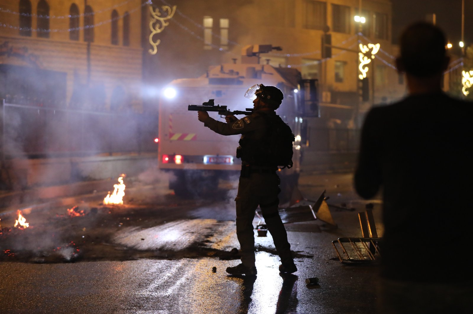 Israeli police fires grenades during a protest at the Damascus gate supporting Palestinian families facing eviction from their homes at the Sheikh Jarrah neighborhood, East Jerusalem, 08 May 2021. (EPA Photo)