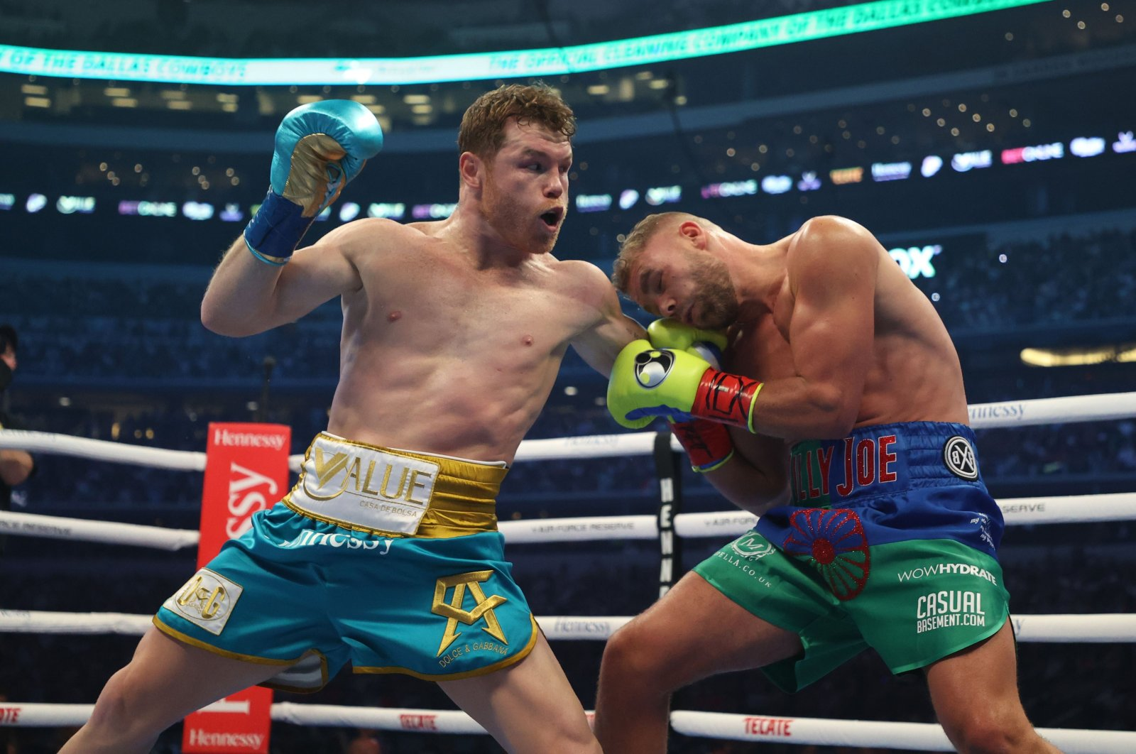 Canelo Alvarez punches Billy Joe Saunders during their fight for Alvarez's WBC and WBA super middleweight titles and Saunders' WBO super middleweight title at the AT&T Stadium, Arlington, Texas, May 08, 2021.