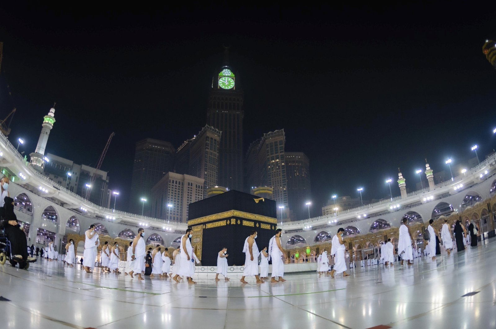 Muslims practice social distancing while praying around the Kaaba in the Muslim holy city of Mecca, Saudi Arabia, Sunday, Oct. 4, 2020. (Saudi Ministry of Hajj and Umrah via AP)