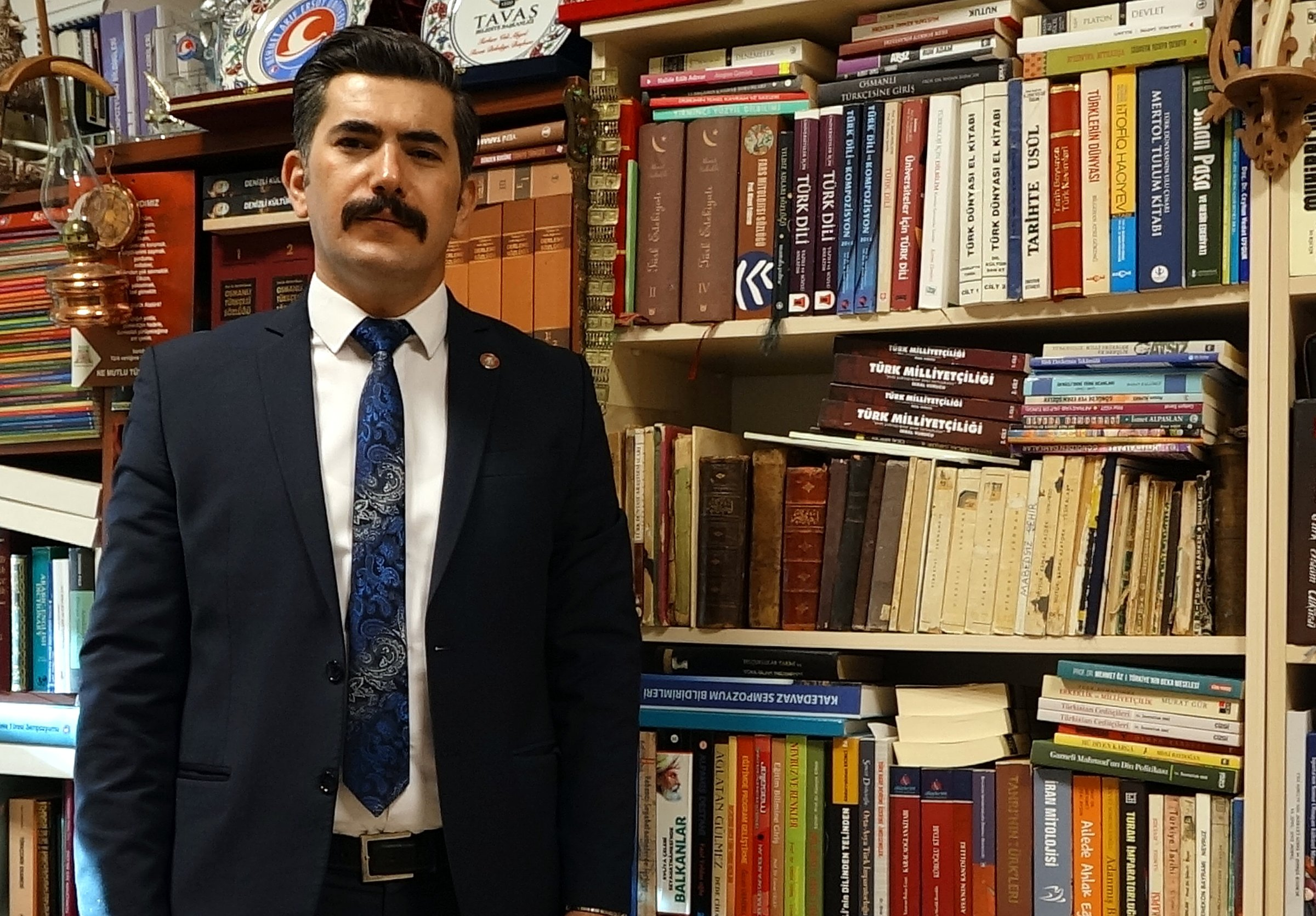 Associate professor Himmet Büke poses in a library, in Turkey, in this photo handout from May 9, 2021. (DHA Photo)