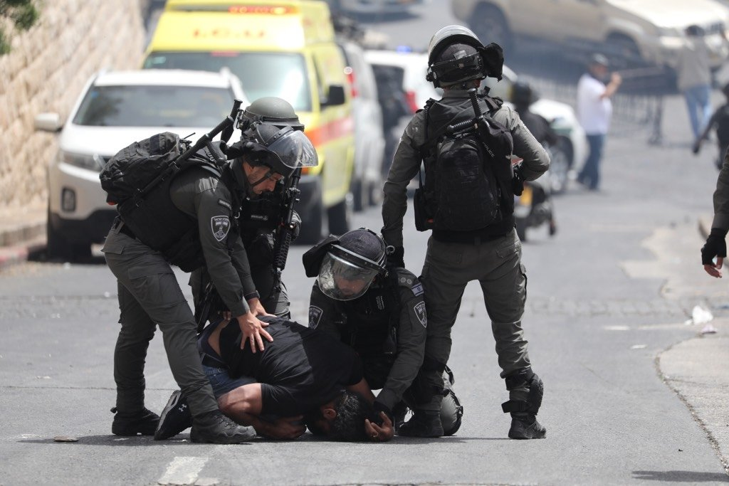 Israeli police push down a Palestinian man at the Lions' Gate, as tensions continue at the Temple Mount in the Old City of Jerusalem, East Jerusalem, occupied Palestine, May 10, 2021. (EPA Photo)