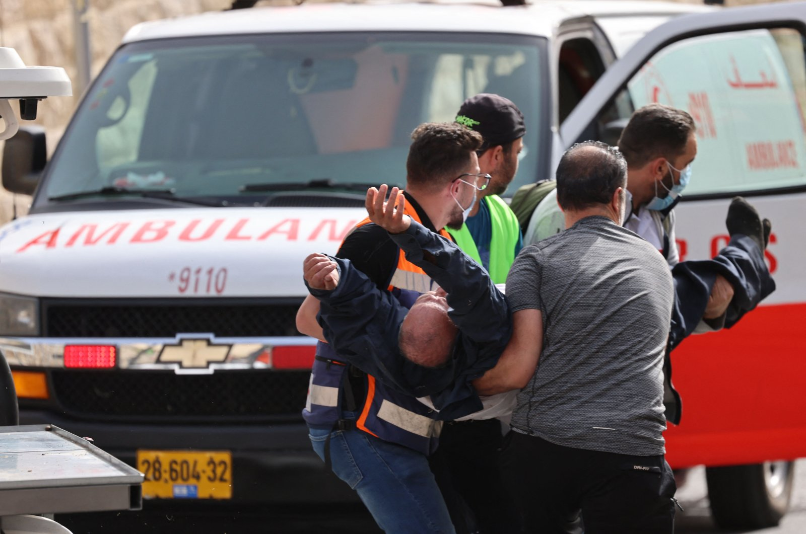 Palestinian medics evacuate a wounded protester after Israeli security forces attacked them at the Damascus Gate in Jerusalem's Old City on May 10, 2021, ahead of a planned march to commemorate Israel's takeover of Jerusalem in the 1967 Six-Day War. (AFP Photo)