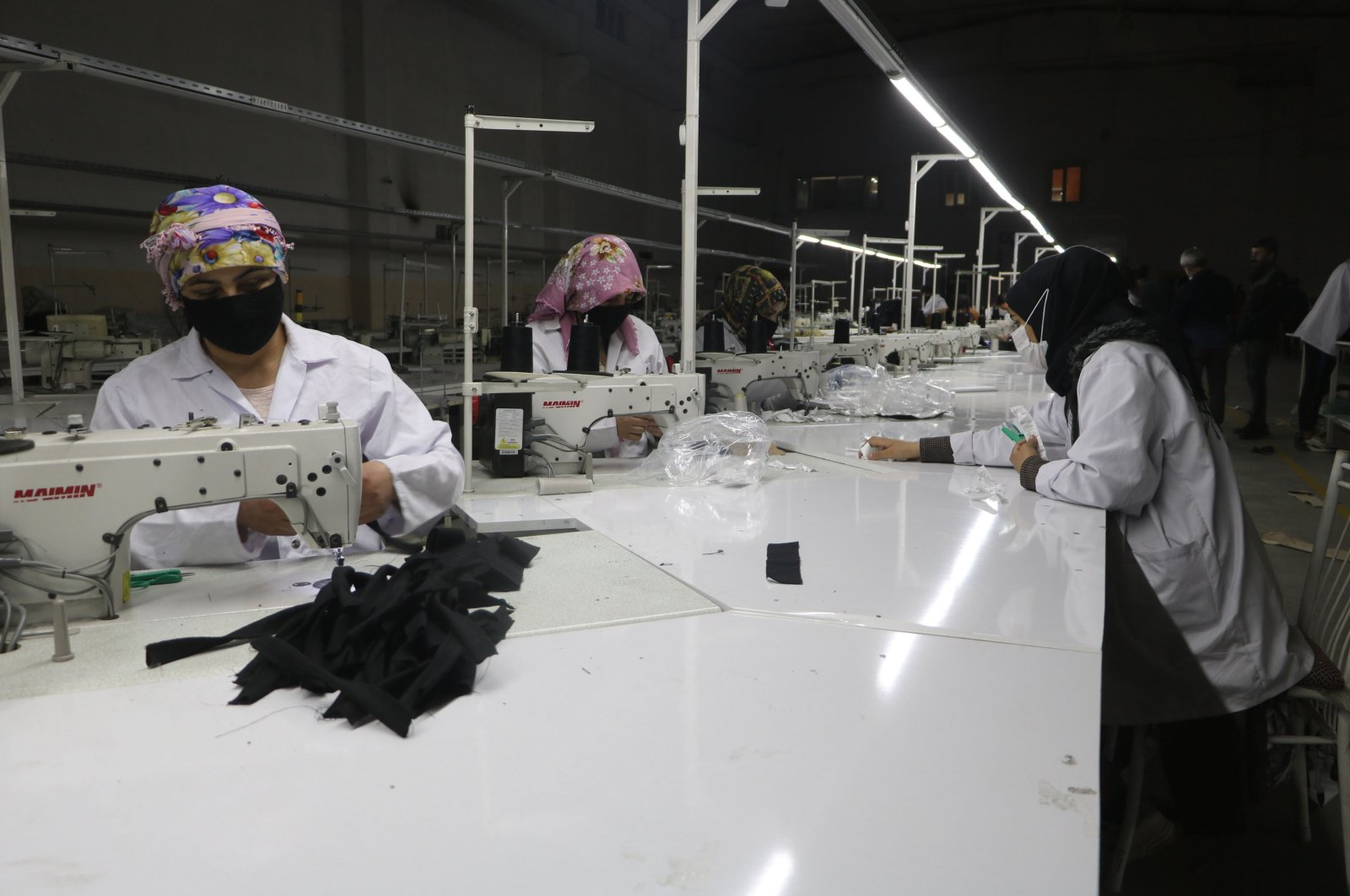Laborers work at a textile factory in Turkey's Hakkari province, May 6, 2021. (DHA Photo)