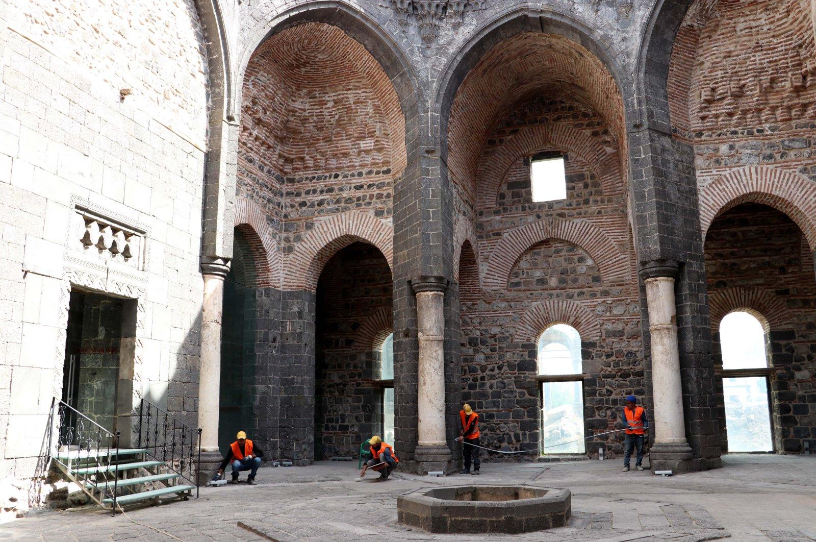 Restorers work in SaintGeorge Church, Diyarbakır, southeastern Turkey, May 6, 2021. (AA Photo)