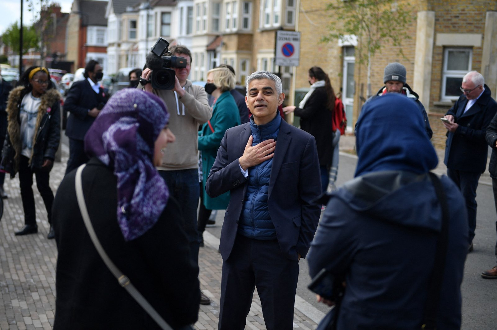 London Mayor Sadiq Khan (C) chats with locals as he campaigns ahead of the London mayoral election, in Waltham Forest, northeast London, U.K., May 5, 2021. (AFP Photo)