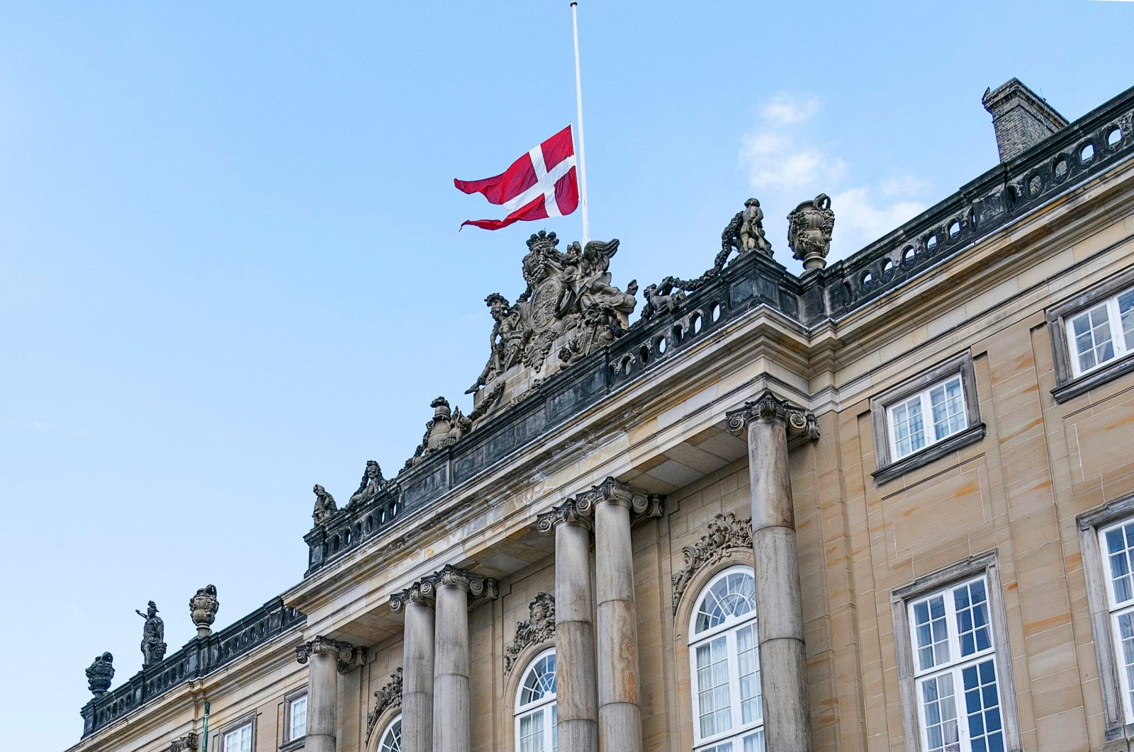The Danish national flag flies at half-mast at Amalienborg Palace in Copenhagen, Denmark, April 17, 2021 (AFP Photo)