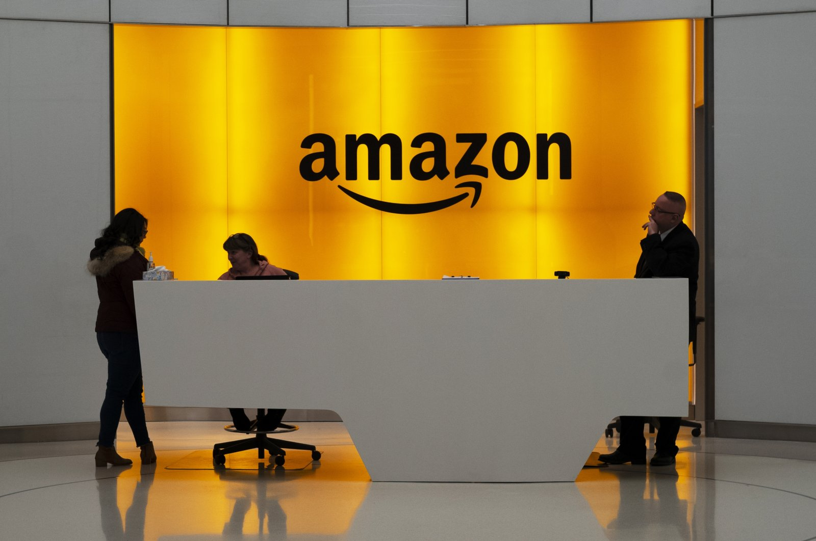 People stand in the lobby of an Amazon office in New York, U.S., Feb. 14, 2019. (AP Photo)