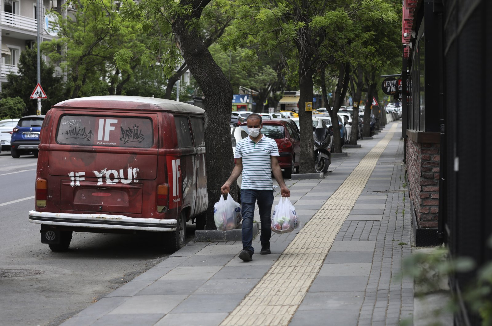 A man walks in a nearly deserted street during the lockdown in the capital, Ankara, Turkey, May 6, 2021. (AP PHOTO)