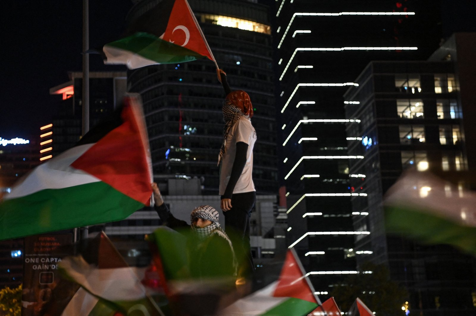 Protesters hold Palestinian and Turkish national flags and chant slogans during a protest against Israel in front of the Israeli Consulate in Istanbul on May 9, 2021. (AFP Photo)