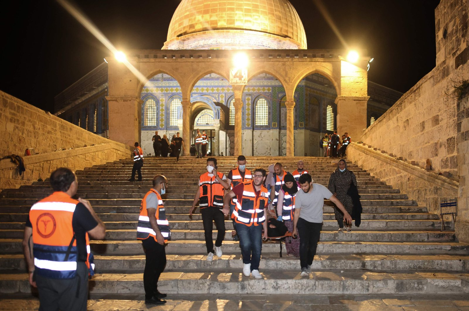 Palestinian medics evacuate a wounded person during attacks of Israeli security forces on Palestinian protestors in Jerusalem's al-Aqsa mosque compound, May 10, 2021. (AFP Photo)