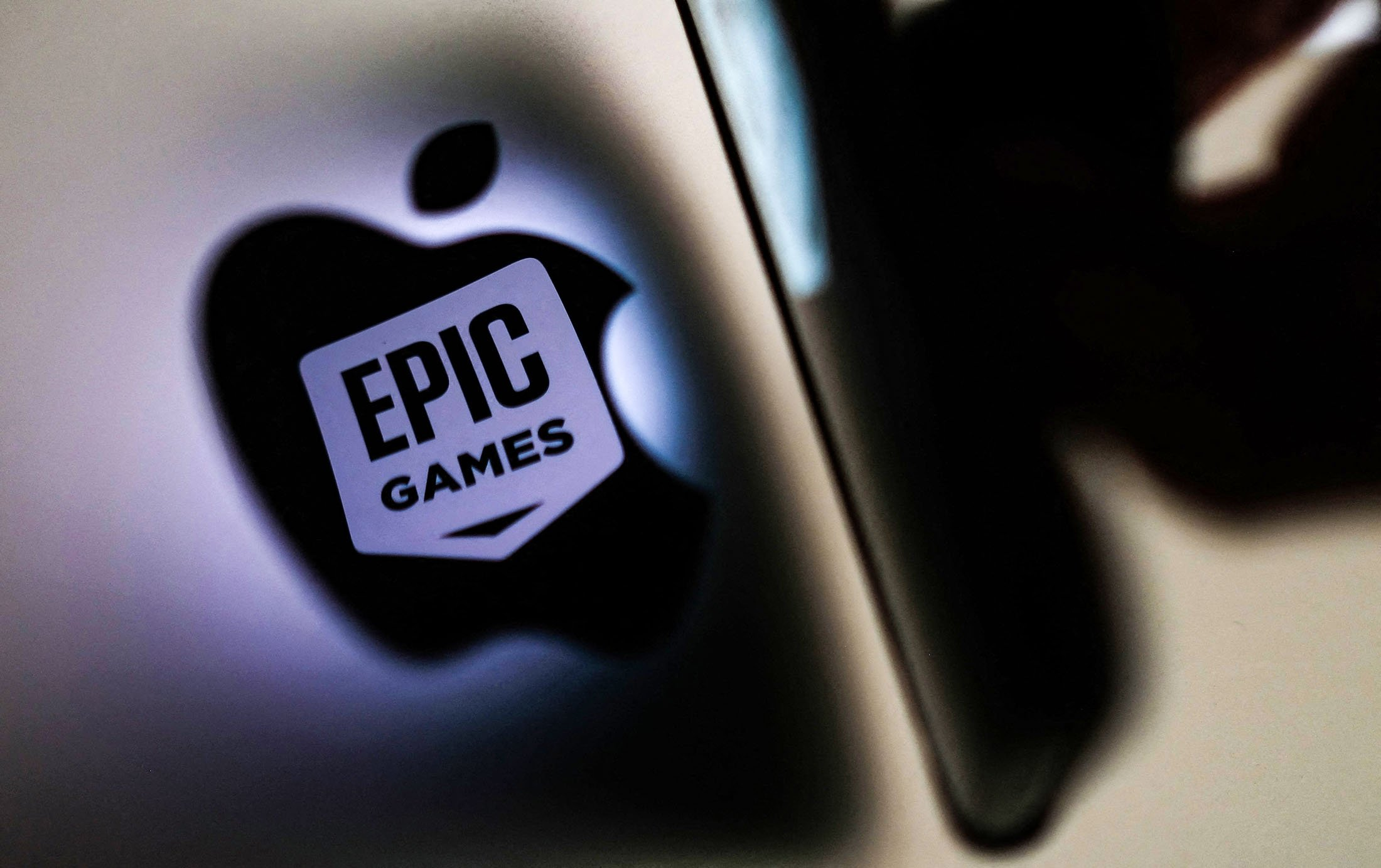 This illustration photo shows the Epic Games logo reflecting onto the Apple logo on the back of an I-mac in Los Angeles, California, U.S., on May 3, 2021. (AFP Photo)