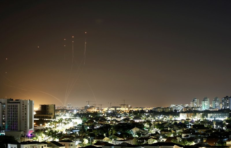 Streaks of light are seen as Israel's Iron Dome anti-missile system intercepts rockets launched from the Gaza Strip towards Israel, as seen from Ashkelon, Israel May 11, 2021. (Reuters Photo)