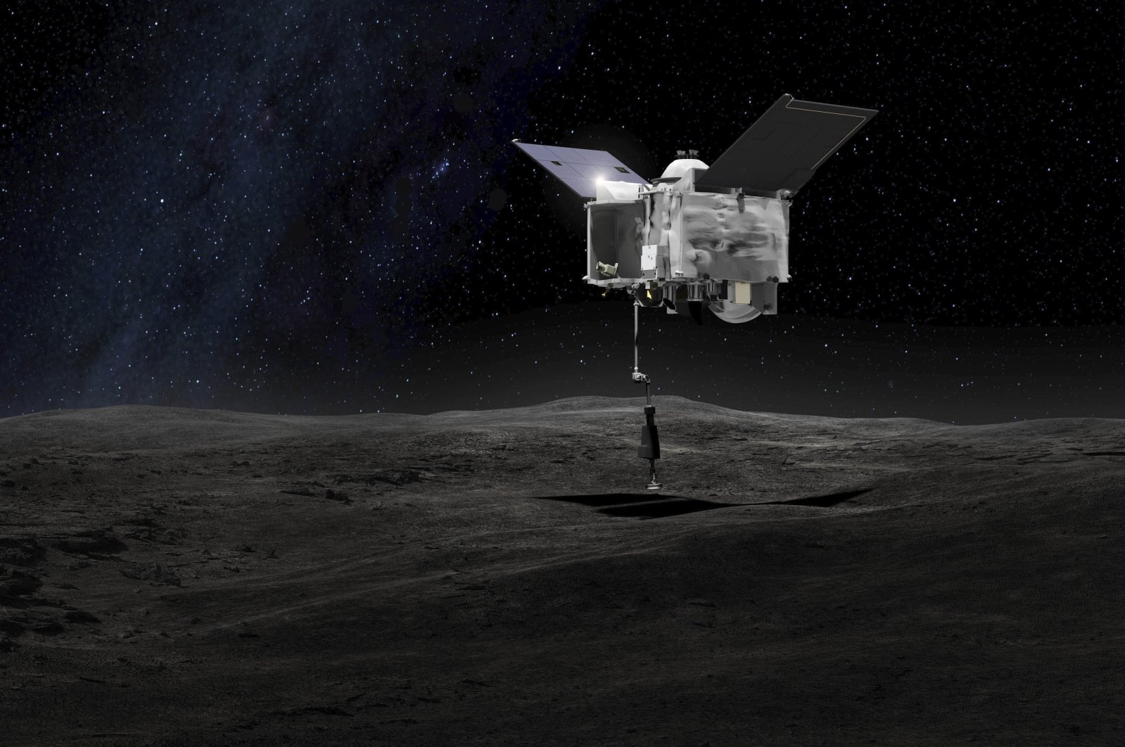 This artist's rendering shows the Origins Spectral Interpretation Resource Identification Security - Regolith Explorer (OSIRIS-REx) spacecraft contacting the asteroid Bennu with the Touch-And-Go Sample Arm Mechanism, made available by NASA on Sept. 6, 2016. (NASA via AP)