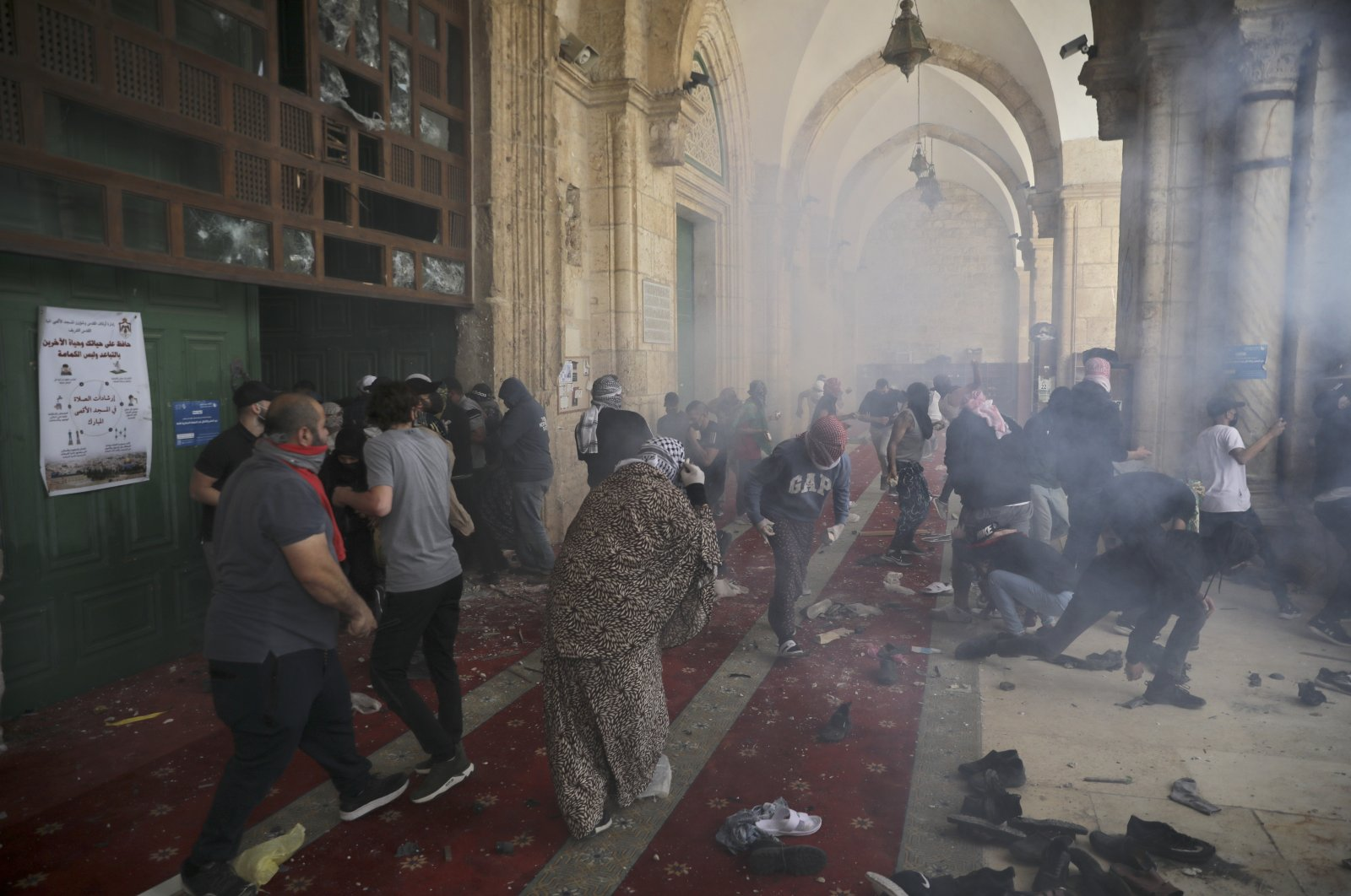 Israeli security forces attack unarmed Palestinian civilians at the Al-Aqsa Mosque compound in the Old City, East Jerusalem, occupied Palestine, May 10, 2021. (AP Photo)