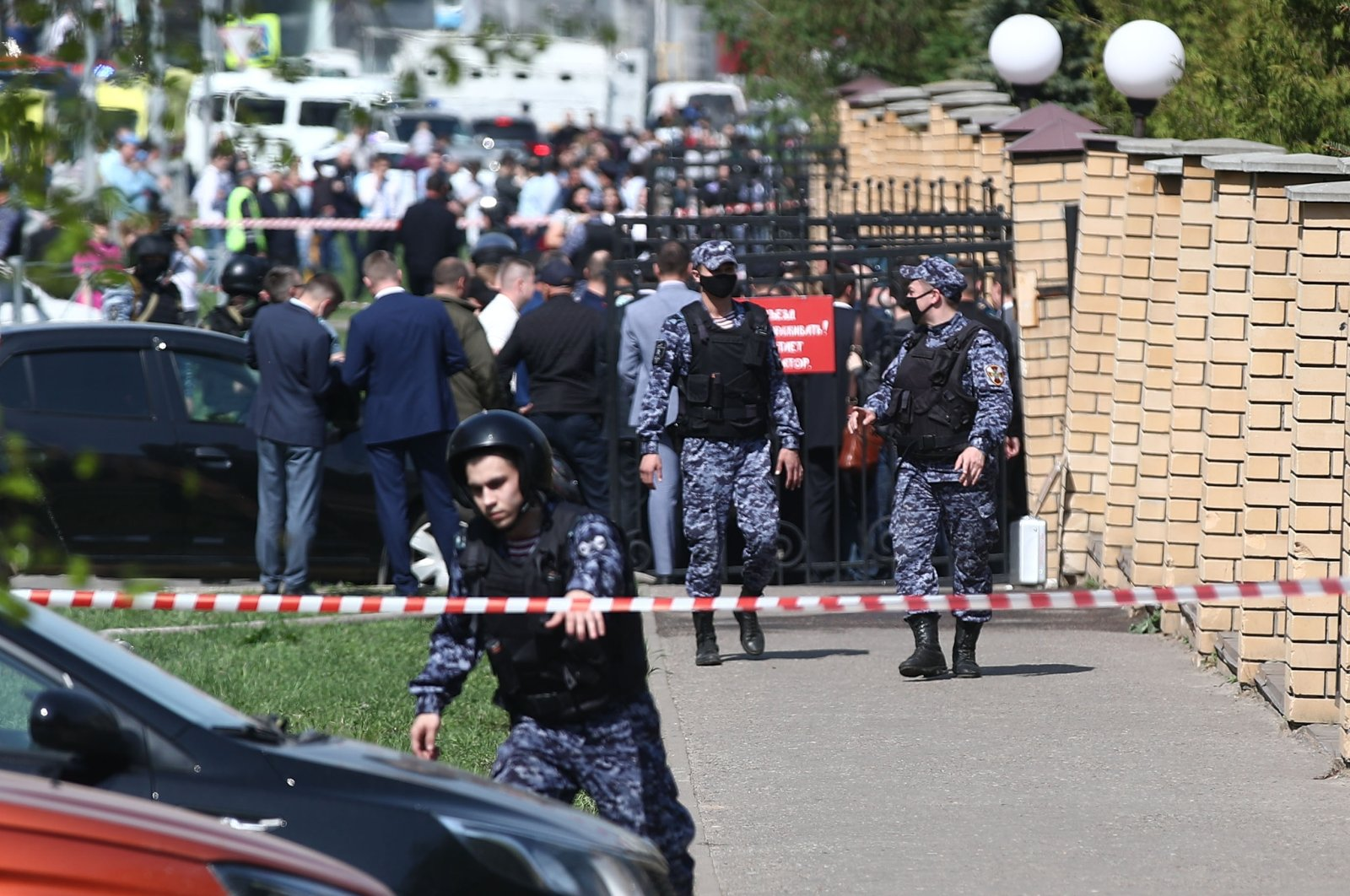 Law enforcement officers are seen at school No. 175 where potentially two attackers opened fire, Kazan, Russia, May 11, 2021. (TASS via Reuters)