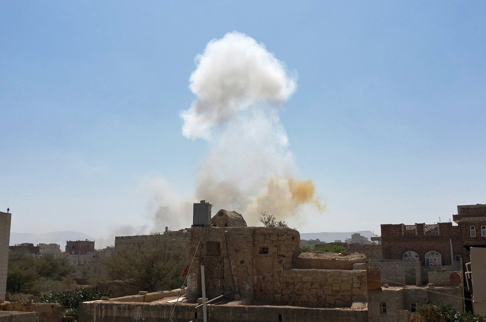 Smoke rises after Saudi-led airstrikes on an army base in Sanaa, Yemen, March 7, 2021. (AP Photo)