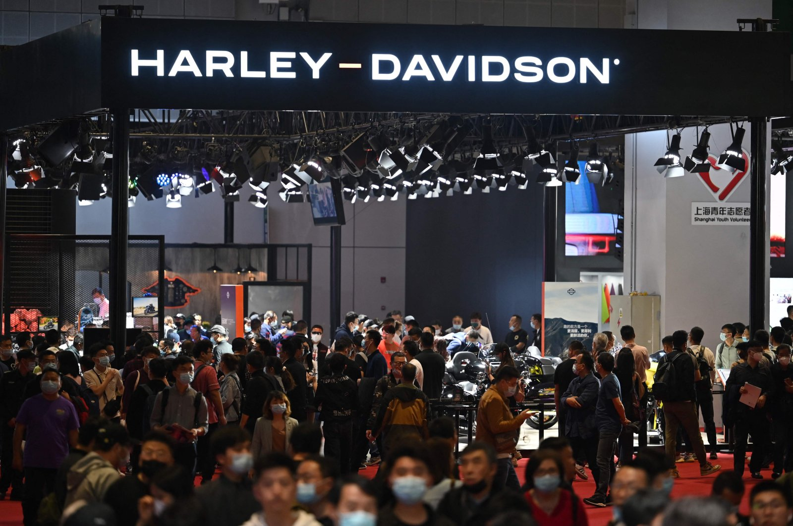 People visit the Harley-Davidson stand at the 19th Shanghai International Automobile Industry Exhibition in Shanghai, China, April 21, 2021. (AFP Photo)