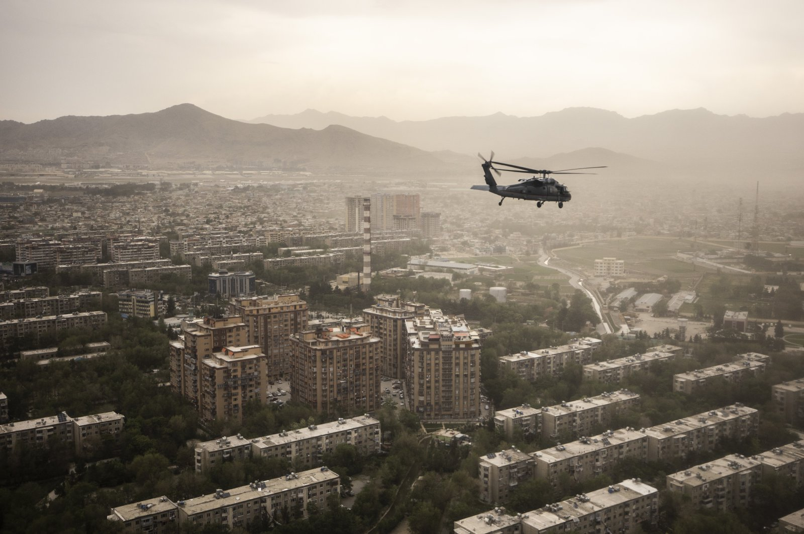 A U.S. Air Force Black Hawk helicopter is pictured in front of the cityscape, in Kabul, Afghanistan, April 29, 2021. (Photo by Getty Images)
