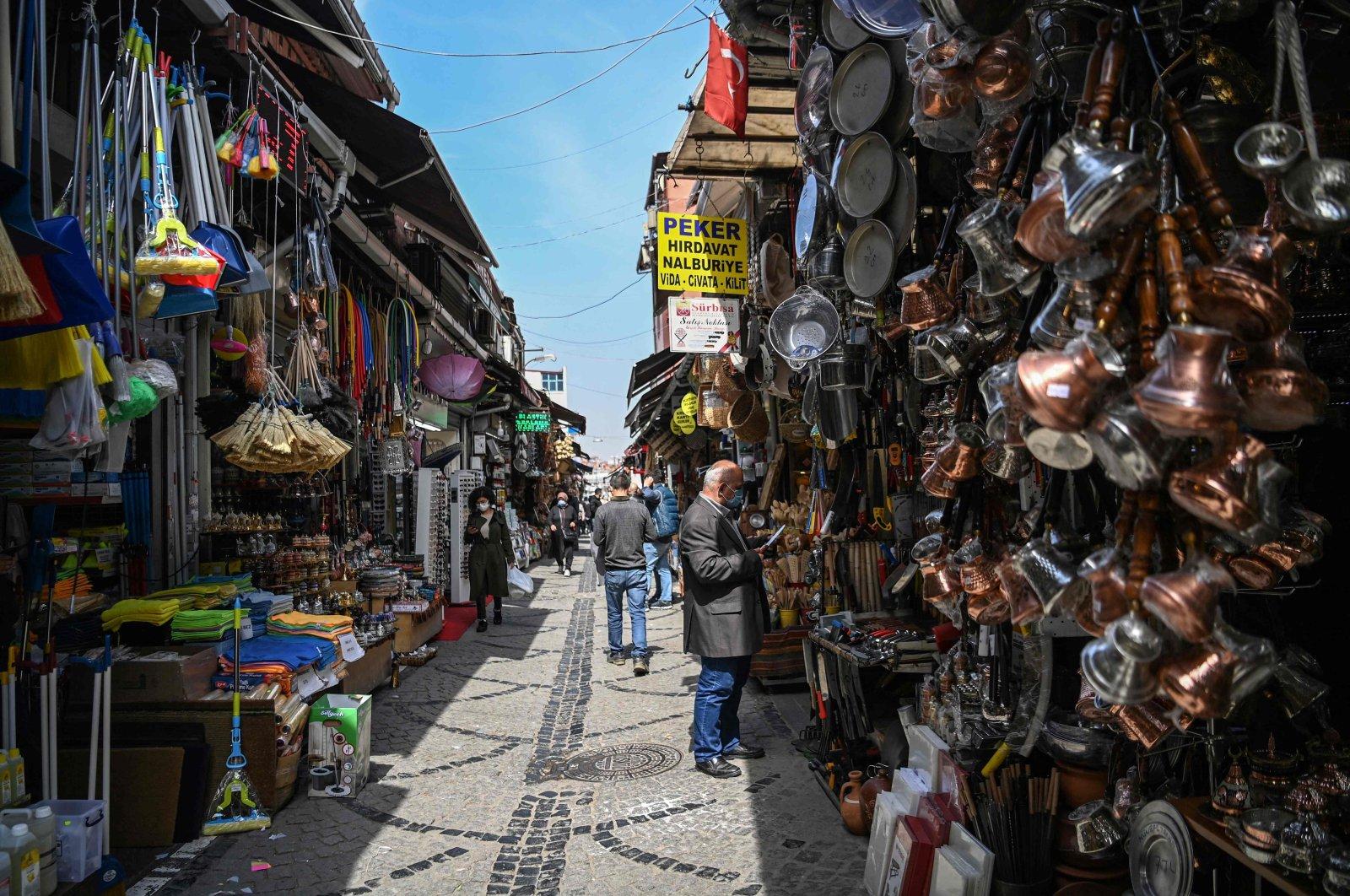 People shop near the Spice Bazaar in the Eminönü neighborhood in Istanbul, Turkey, April 27, 2021. (AFP Photo)