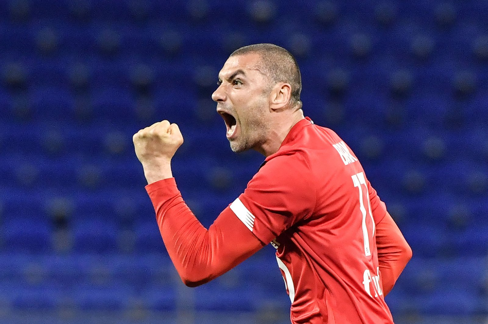 Lille's Turkish forward Burak Yilmaz reacts after scoring against Olympique Lyonnais in a French Ligue 1 match at the Groupama Stadium, in Decines-Charpieu near Lyon, south-central France, April 25, 2021. (AFP Photo)