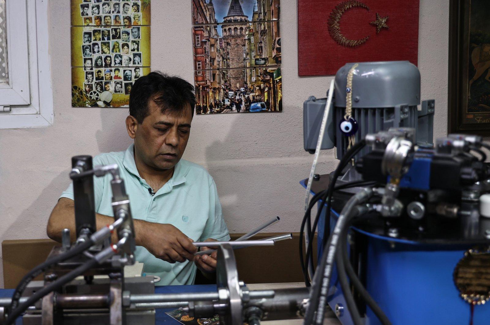 Visually impaired entrepreneur, Ayhan Öztürk, works in his workshop, in Istanbul, Turkey, on May 11, 2021. (AA Photo)