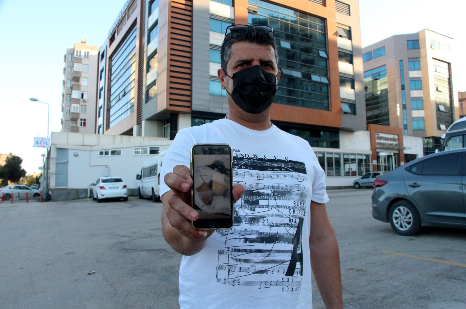 Cengiz Balcı shows a photo of the severed fingers he found, in Adana, southern Turkey, May 11, 2021. (DHA PHOTO)