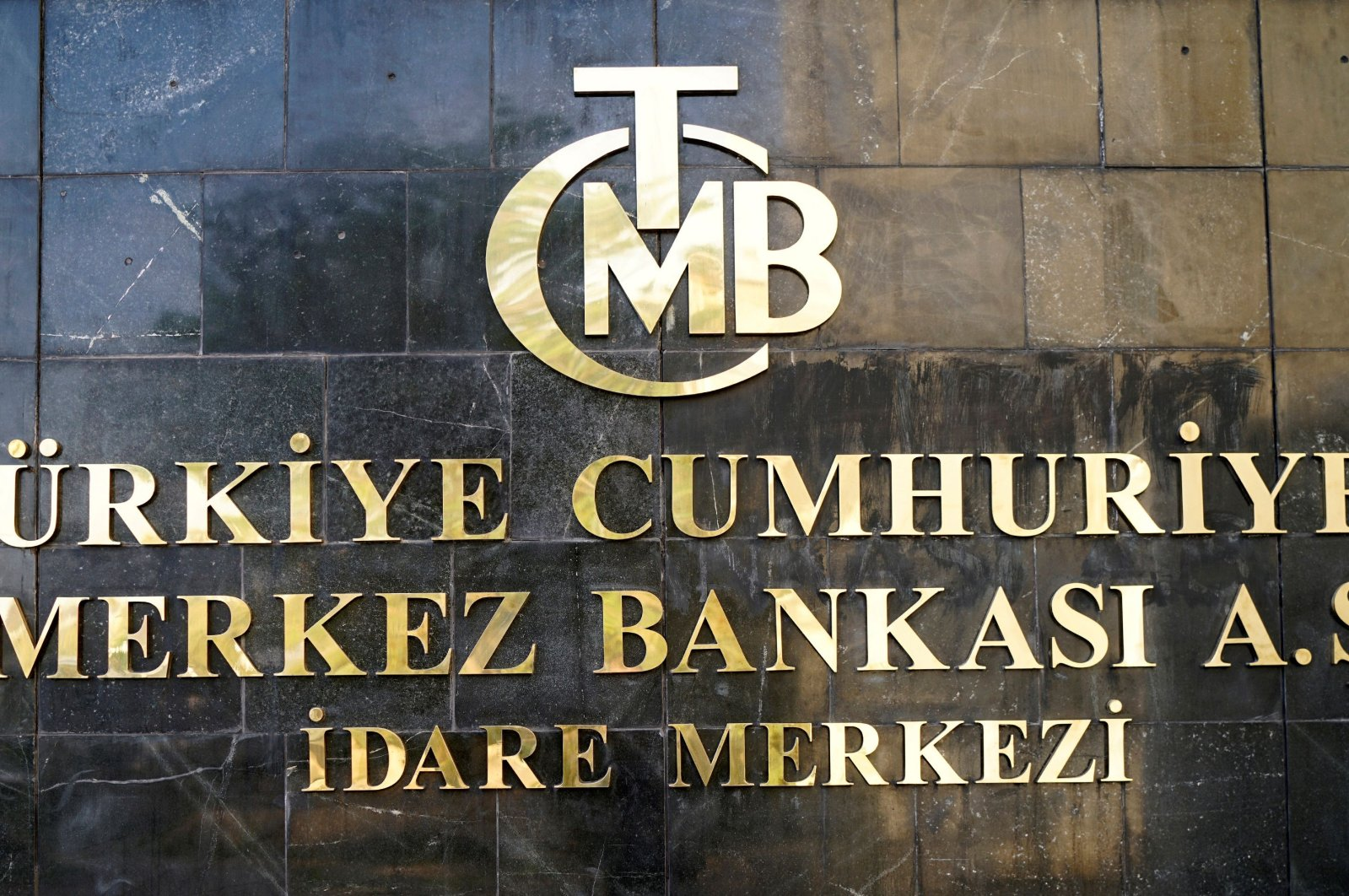 The logo of the Central Bank of the Republic of Turkey (CBRT) at the entrance of the bank's headquarters in Ankara, Turkey, April 19, 2015. (Reuters Photo)