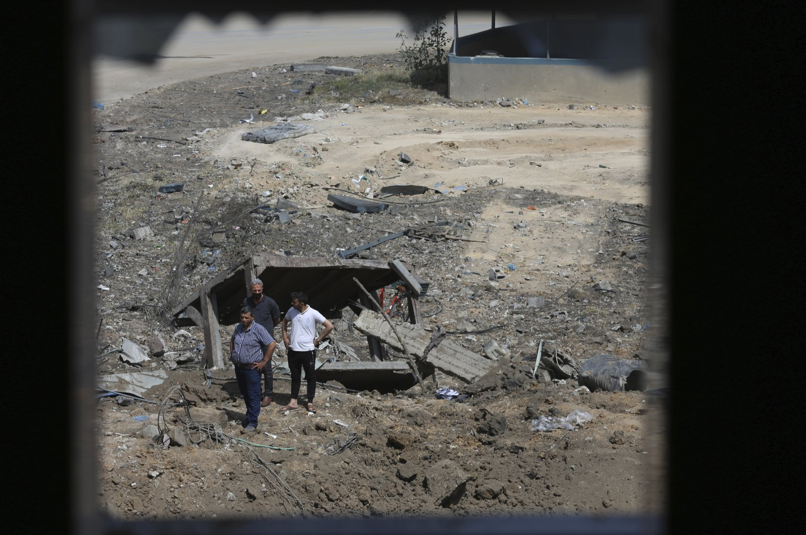 Palestinians inspect the rubble of an ice factory and mechanics garages destroyed by Israeli airstrikes, in Gaza City, Palestine, May 11, 2021. (AP Photo)