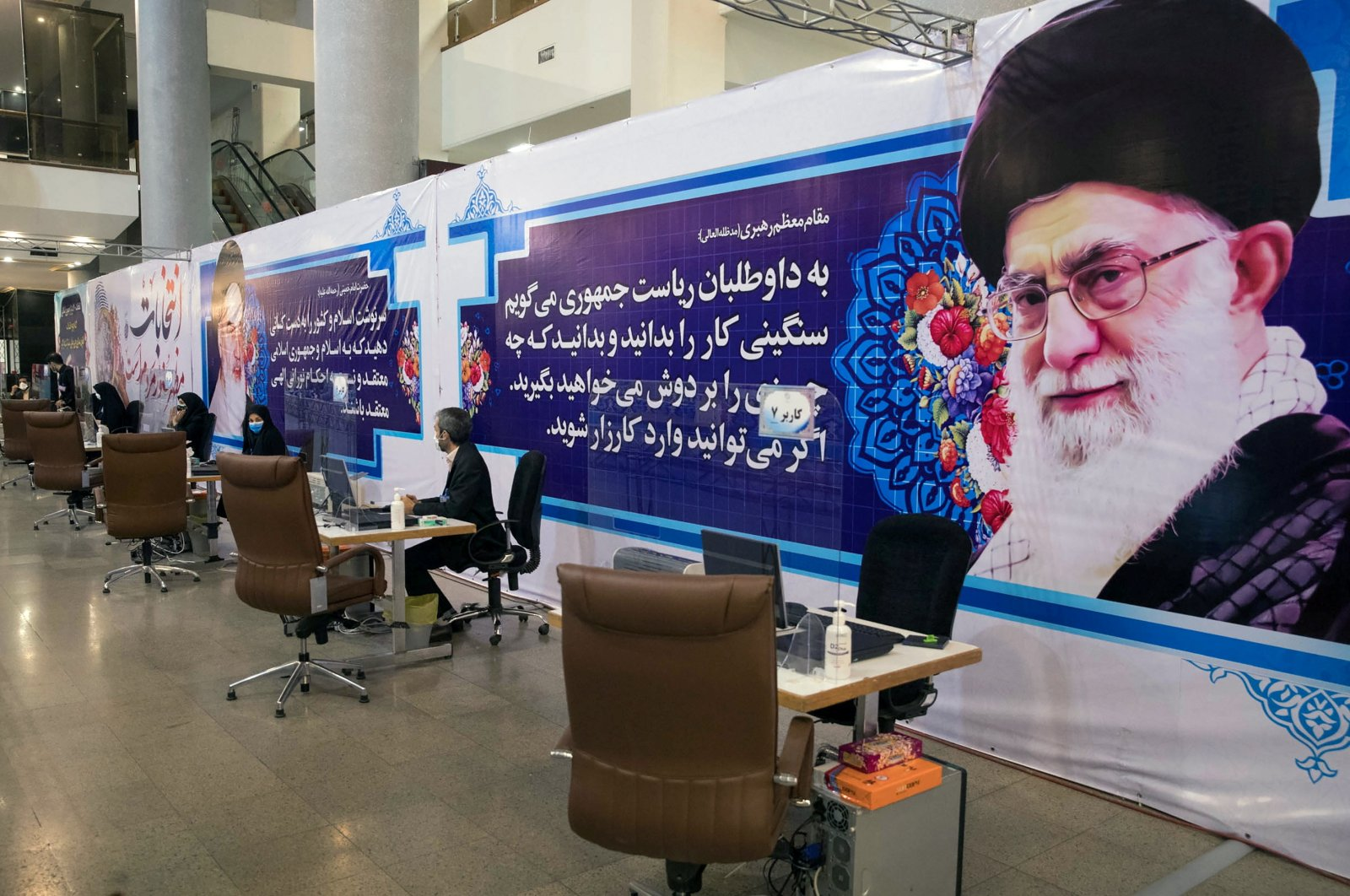 Elections headquarters staff wait to receive candidates to register for Iran's presidential election at the Interior Ministry, in Tehran, Iran, May 11, 2021. (West Asia News Agency via Reuters)
