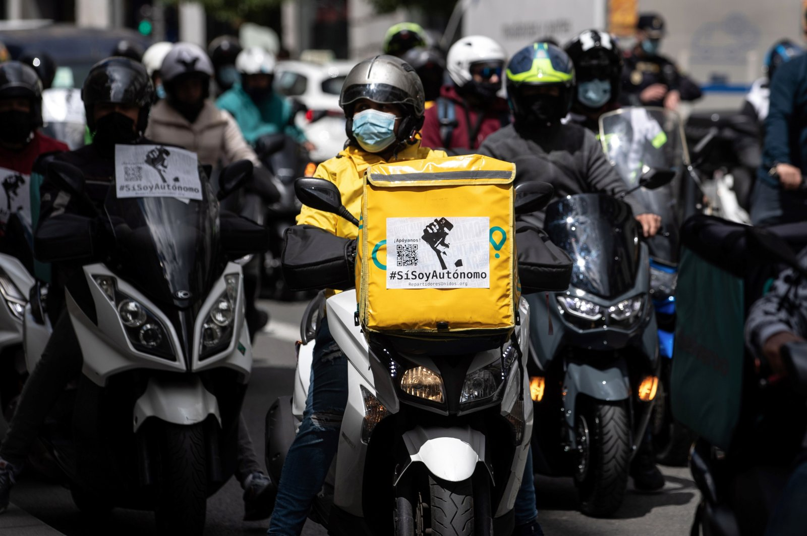 A group of delivery riders protests against the law approved by the government's Cabinet that regulates their activity in Madrid, Spain, May 11, 2021. (EPA Photo)
