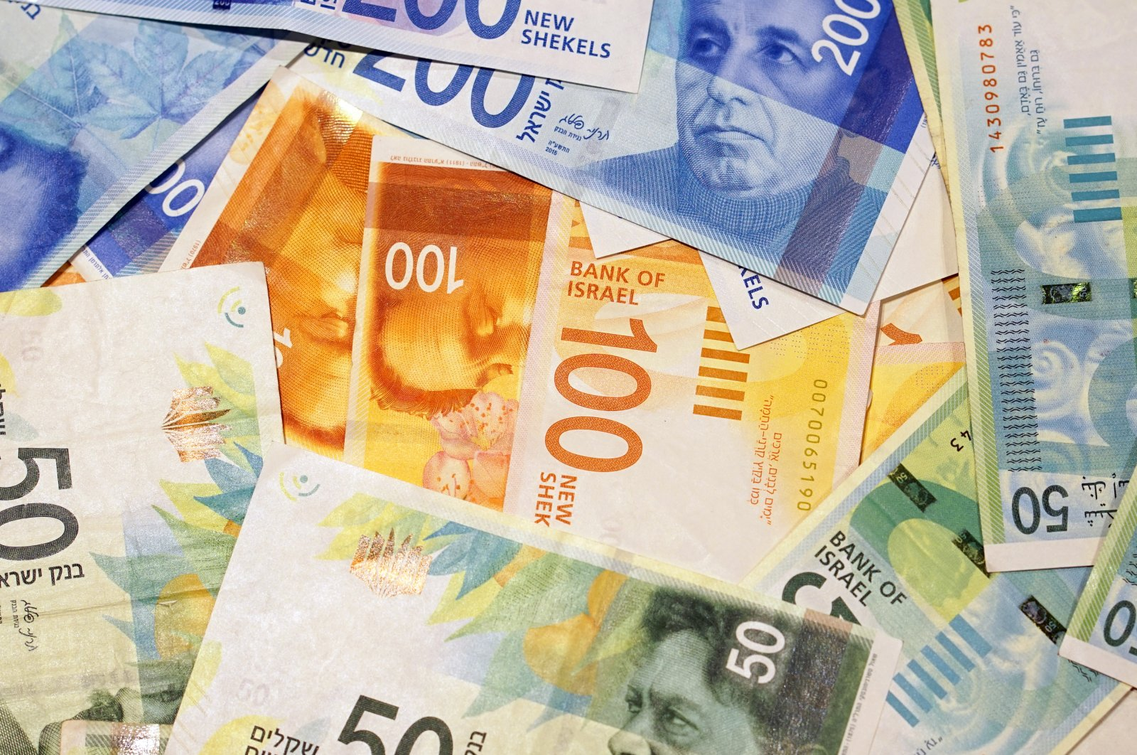 Israeli banknotes of 50, 100 and 200 shekels seen in this undated file photo. (Shutterstock Photo)