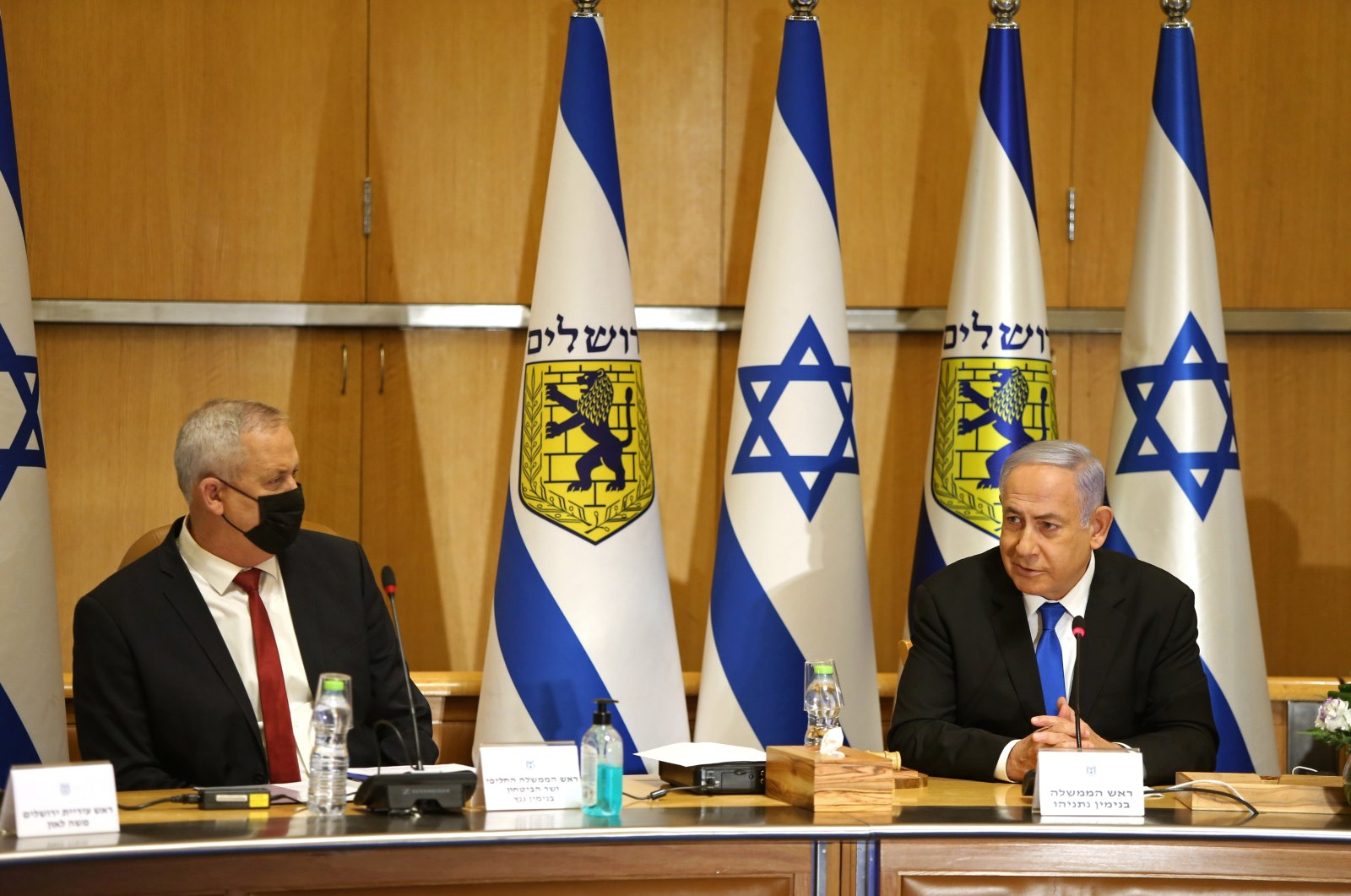 Israeli Prime Minister Benjamin Netanyahu, right, and Minister of Defense Benny Gantz attend a special cabinet meeting on the occasion of Jerusalem Day, at the Jerusalem Municipality building, in Jerusalem, Sunday, May 9, 2021. (AP Photo)