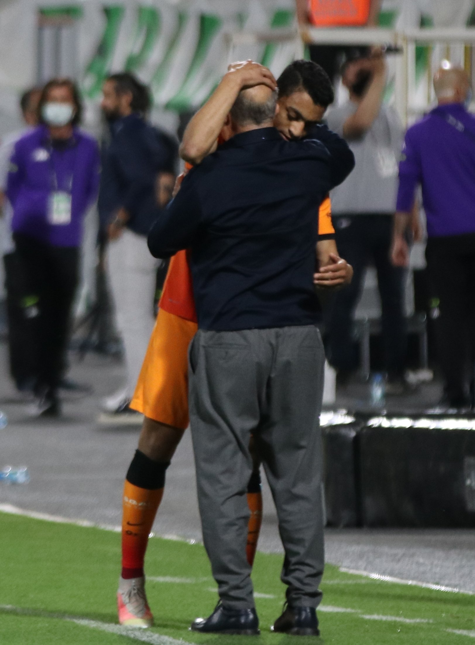 Galatasaray's Egyptian striker Mostafa Mohamed and the club's legendary coach Fatih Terim hug each other after a penalty goal at the Atatürk Stadium in southwestern Denizli province on May 11, 2021 (AA Photo)