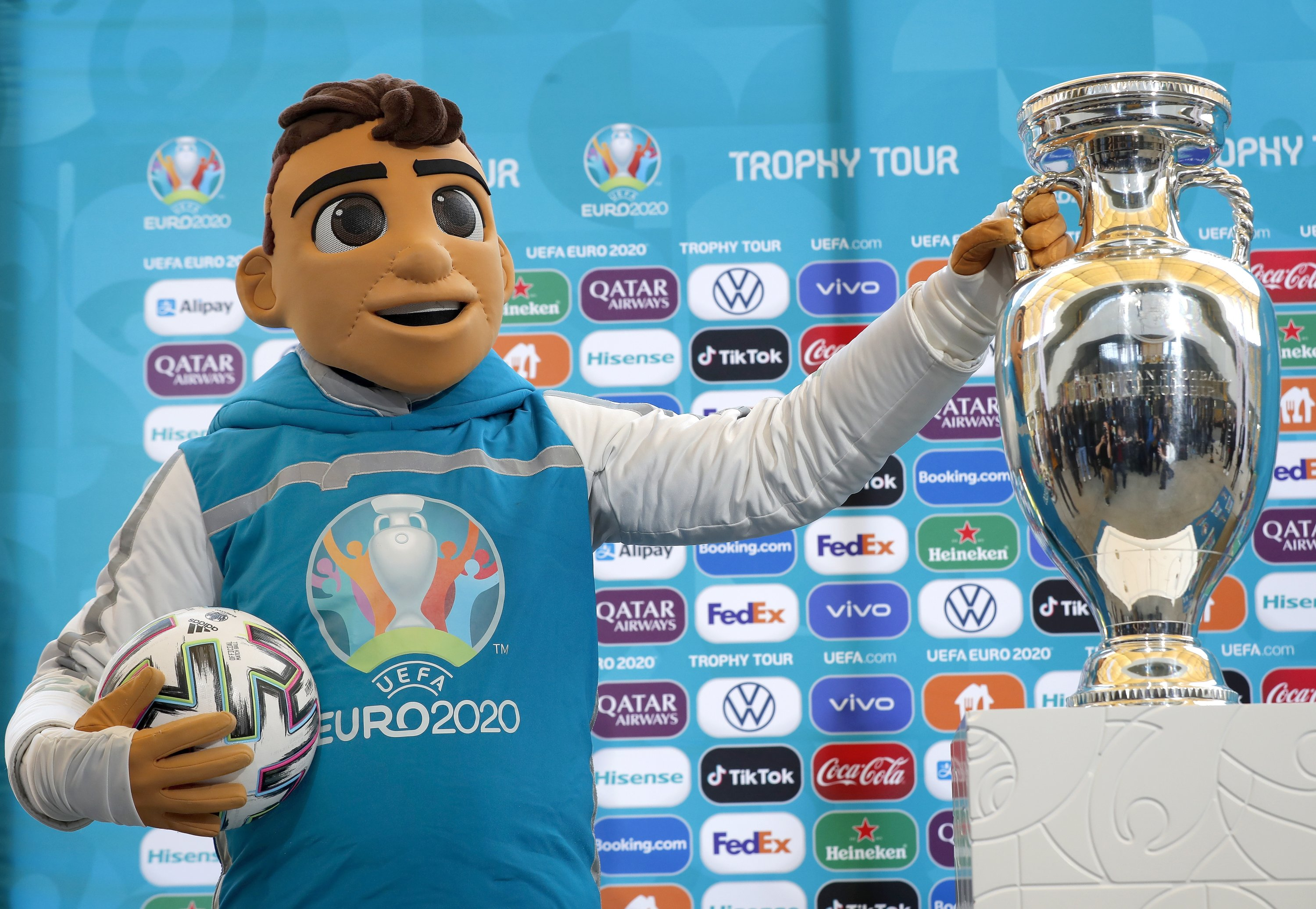 The UEFA Euro 2020 mascot Skillzy poses with the Trophy during a presentation ceremony in Bucharest, Romania, April 25, 2021 (EPA Photo)