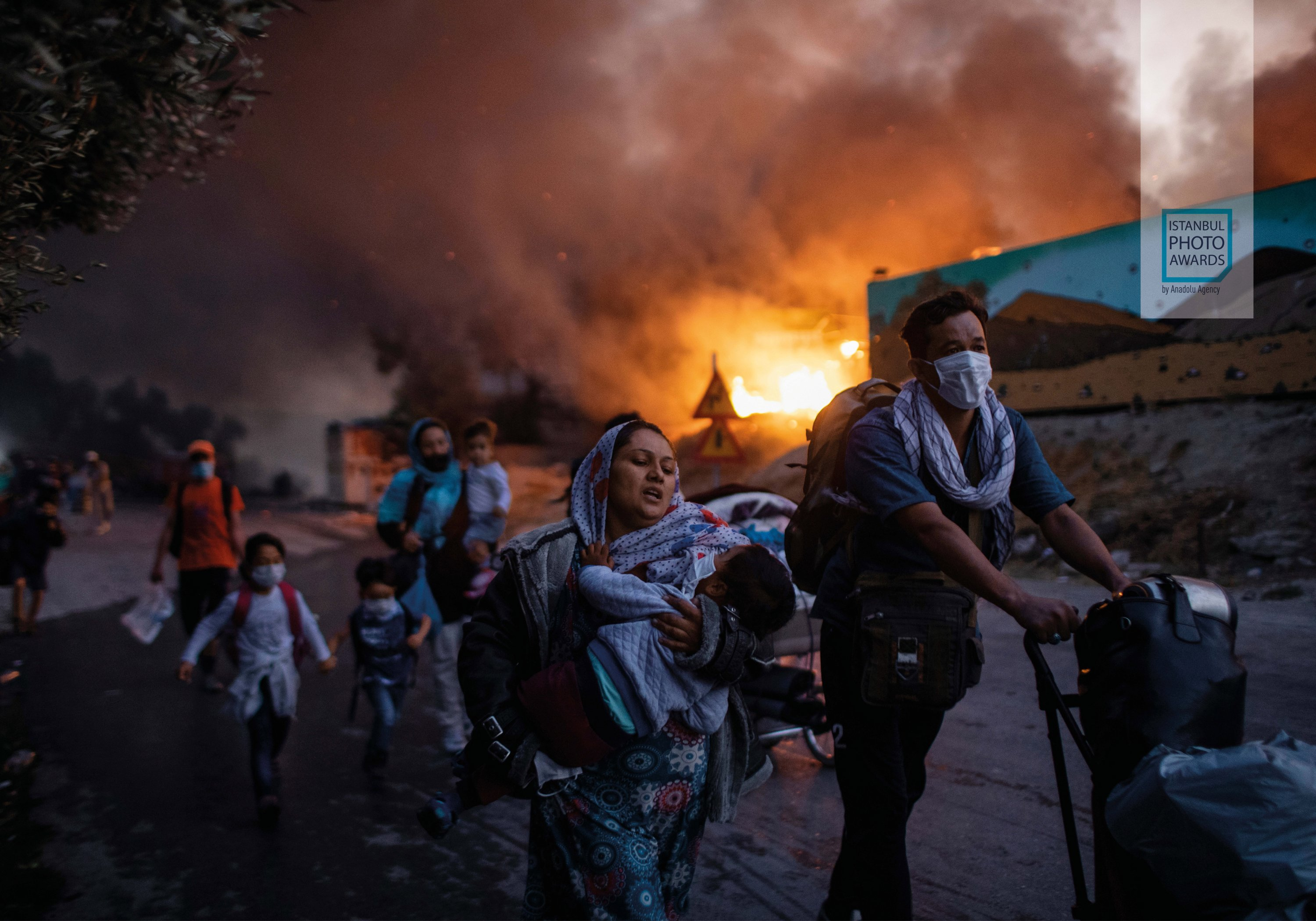 """""""Fleeing a Fire Burning Refugee Camp' by AP photojournalist Petros Giannakouris. (AA Photo)"""