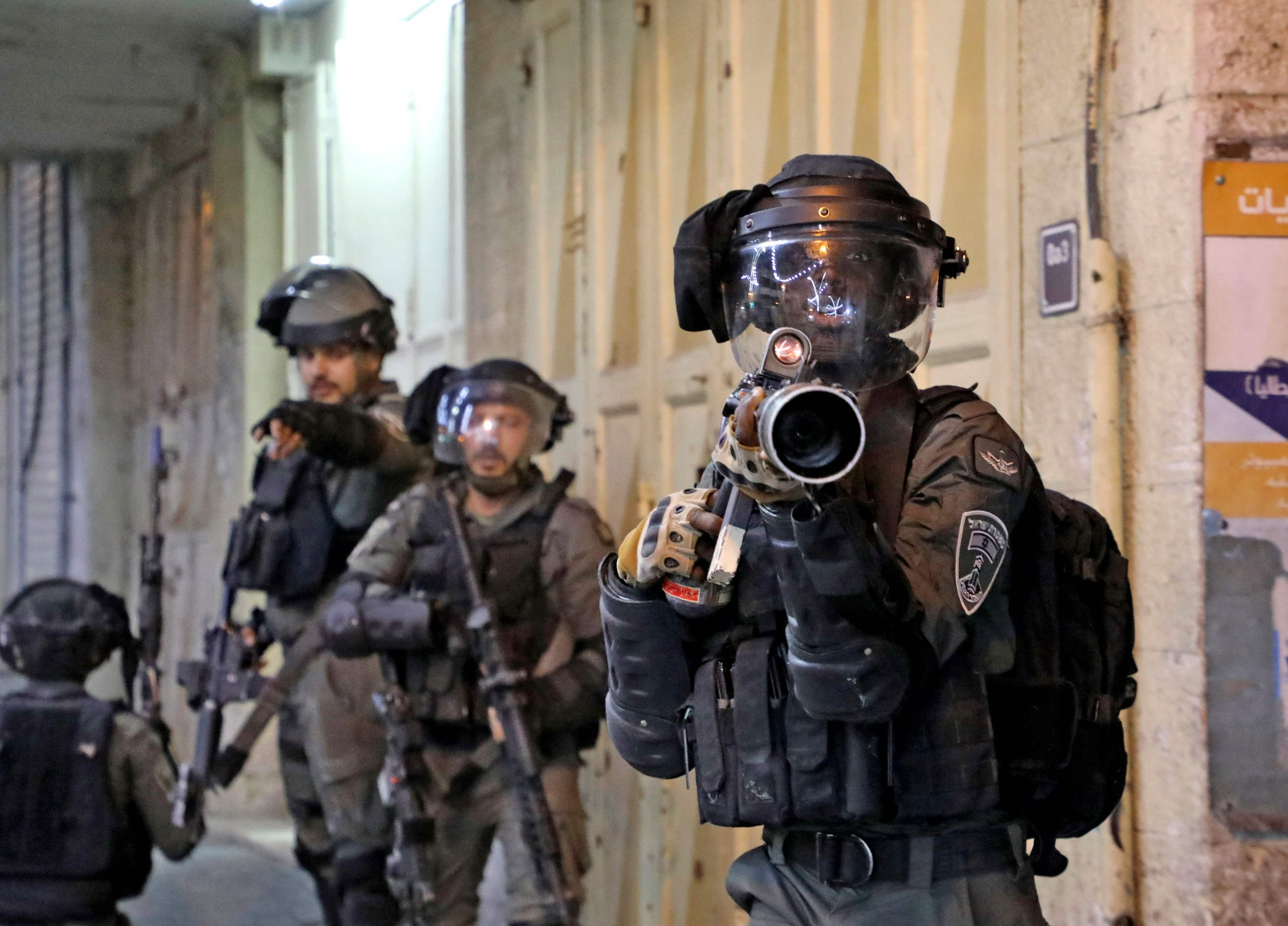 Israeli forces take position amid Palestinian protests in Hebron, occupied West Bank, May 12, 2021. (AFP Photo)