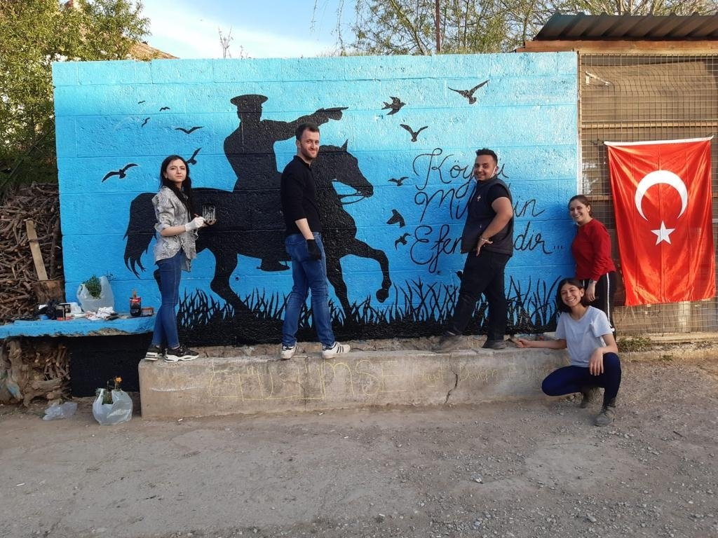 Gamze Atmaca and her neighbors paint a wall during the renovation, in Denizli, Turkey, May 12, 2021. (AA Photo)