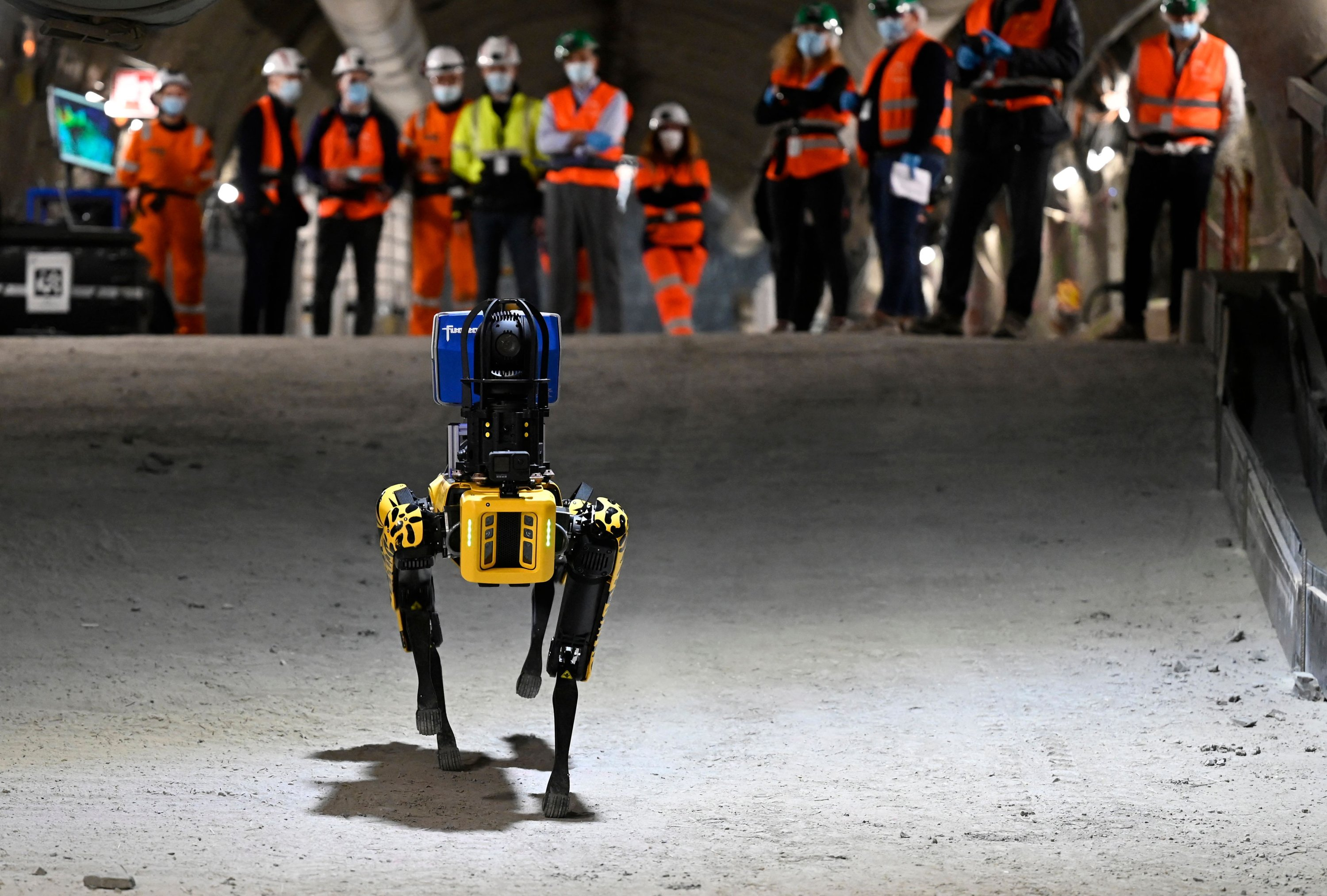 Researchers watch on as robot-dog Scar navigates a corridor in the underground laboratory at Bure, near Nancy, eastern France, May 11, 2021. (AFP)