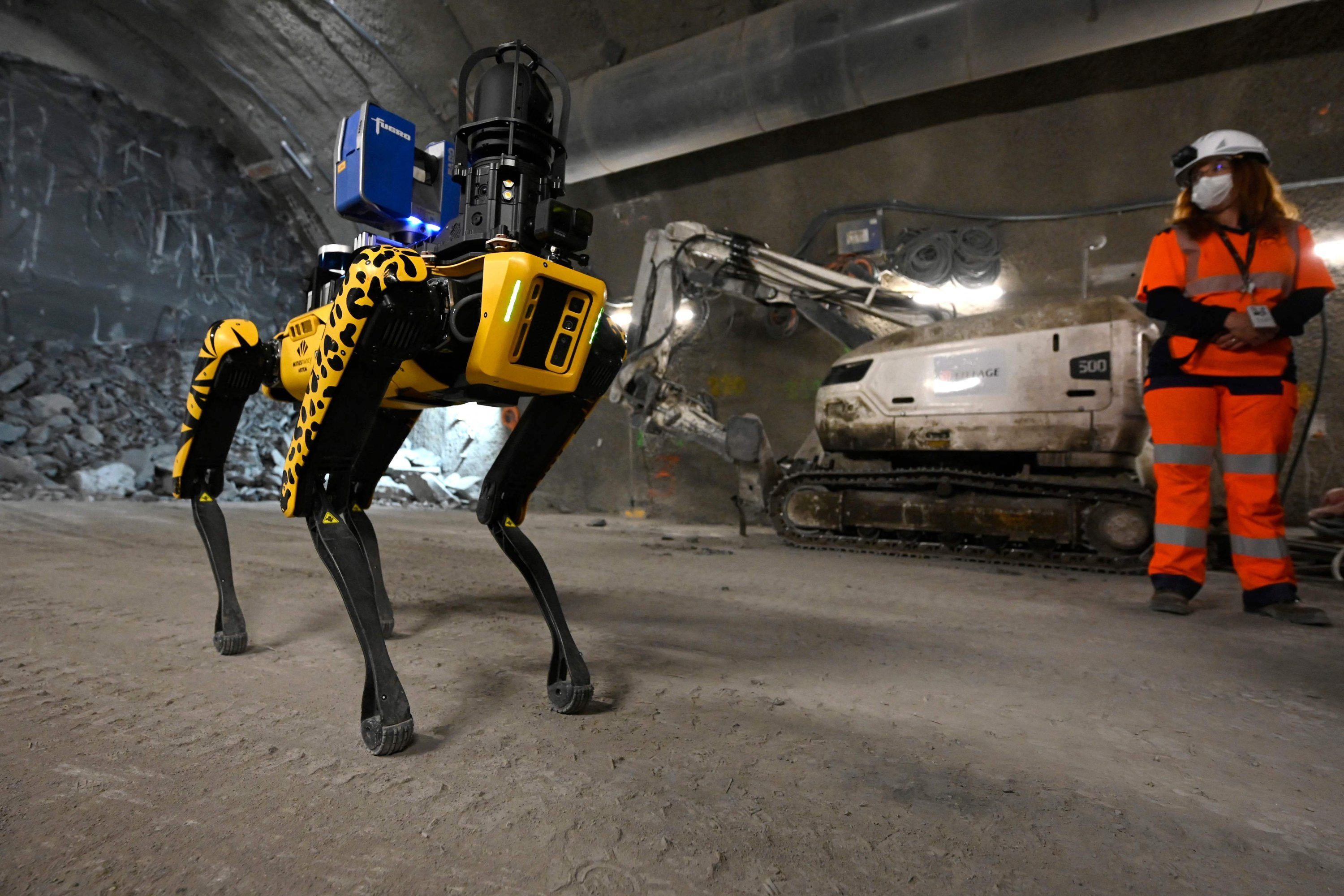 A researcher watches Scar, the robotic dog, in the underground laboratory at Bure, near Nancy, eastern France, May 11, 2021. (AFP)